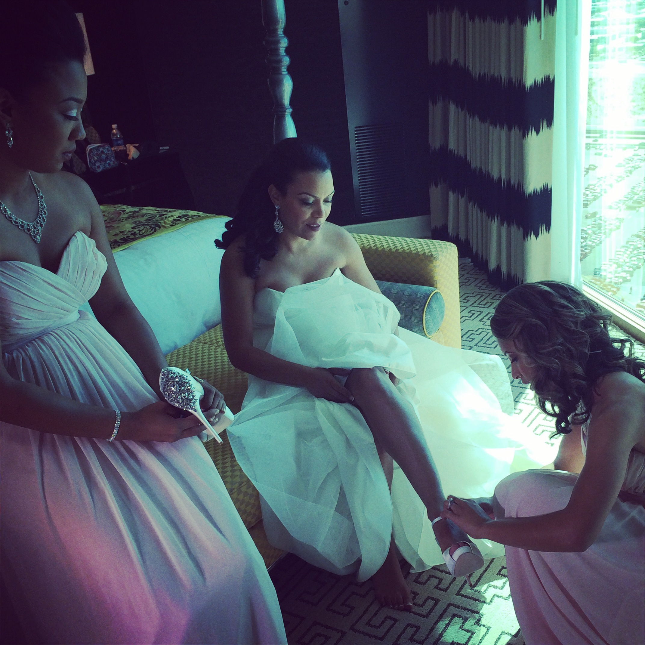 The bride was surrounded by her sisters and friends while she dressed in the Presidential Suite of the Four Seasons Las Vegas.