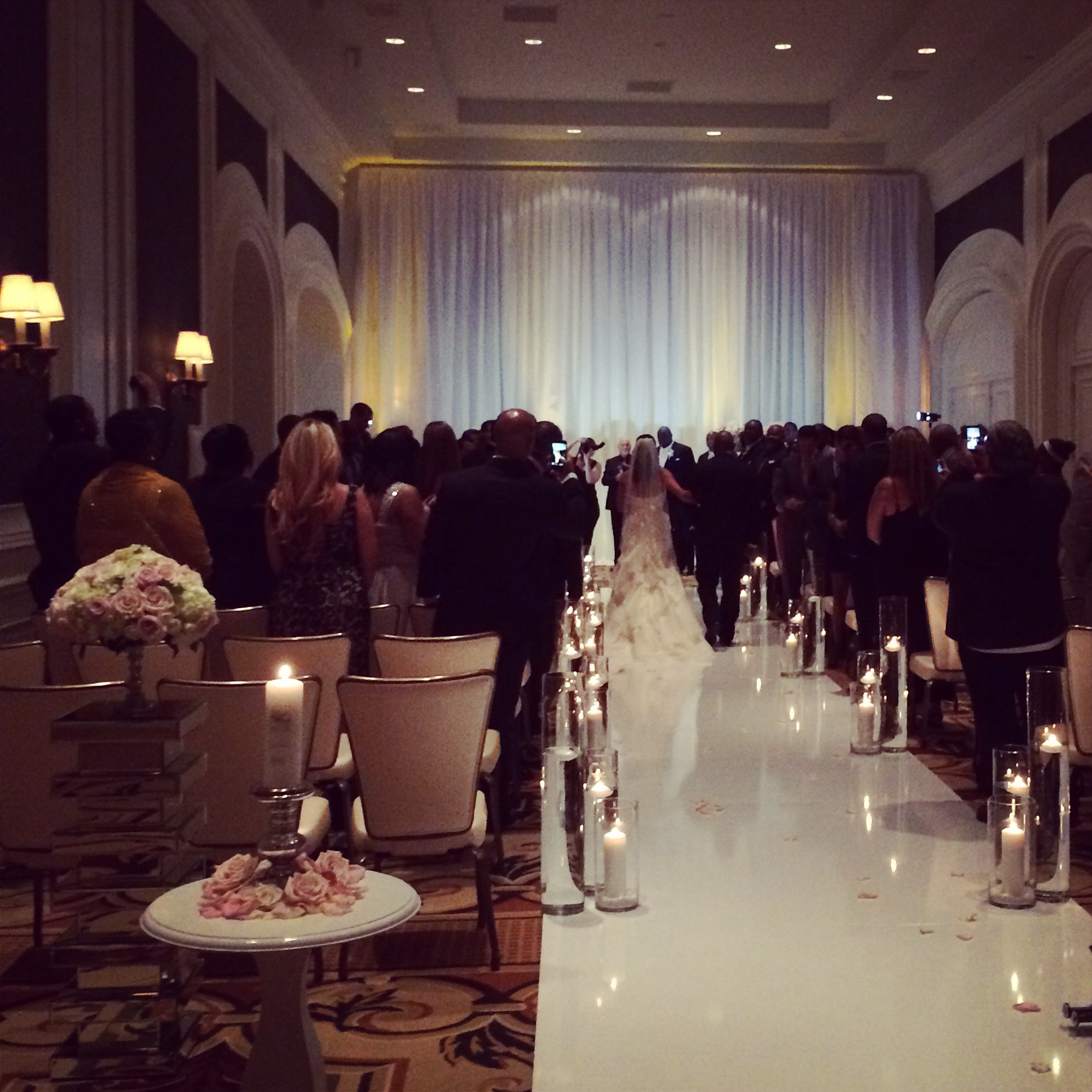 The bride was escorted down the aisle by her father, while a candle honoring her mother stood by.