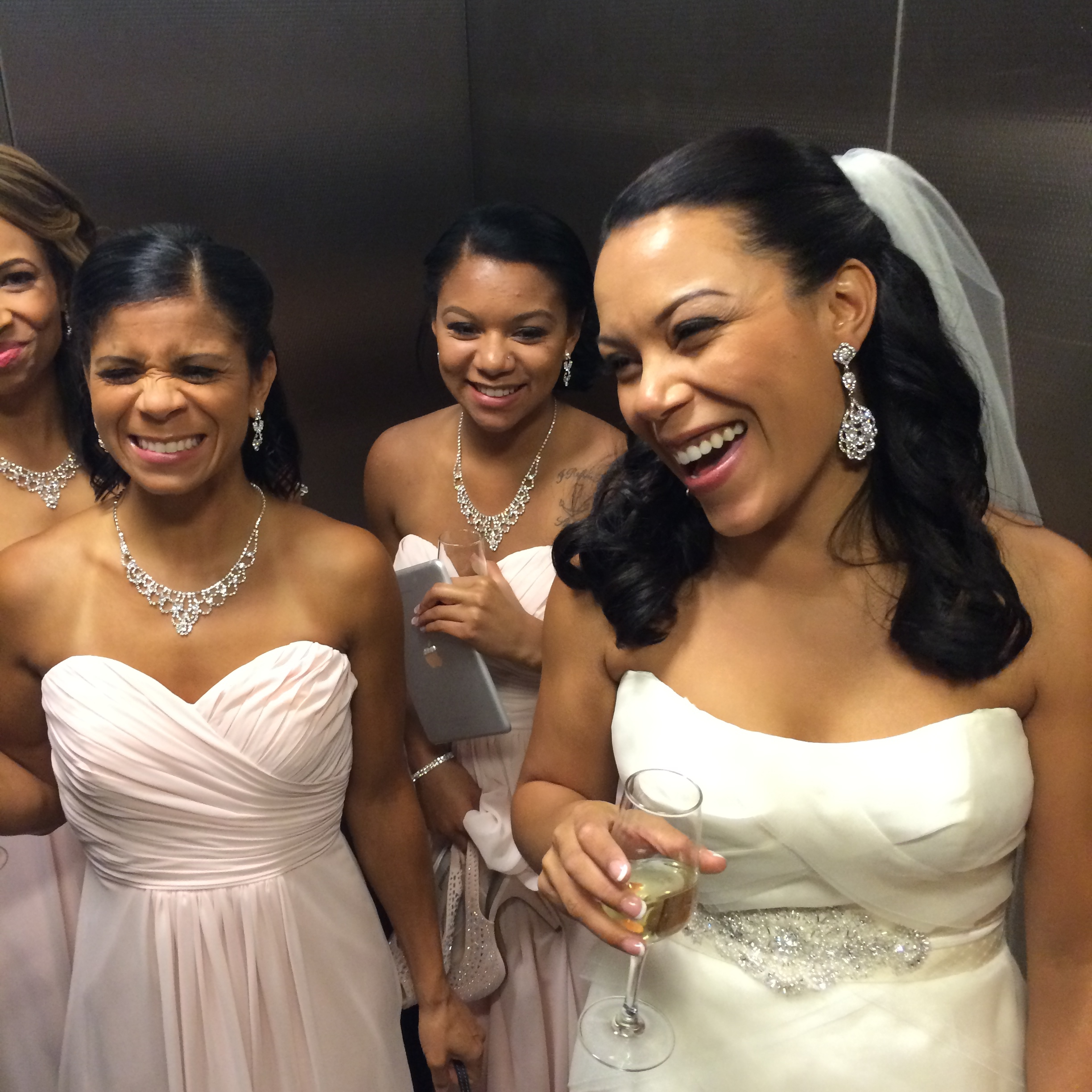 Halona & her bridesmaids laughed at the craziness surrounding the NBA Summer Series - avoiding the players and her guests by taking a service elevator down to meet her groom.
