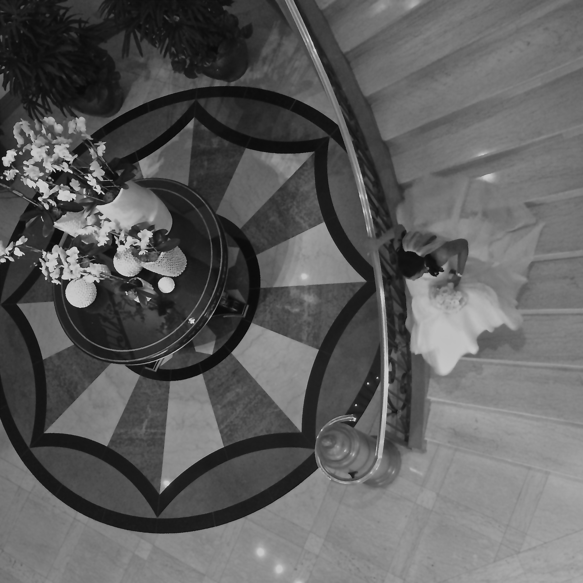 The bride walked down the curved staircase to meet her groom.