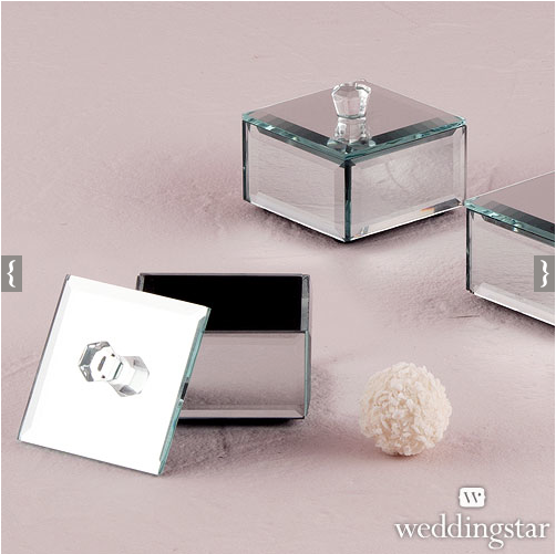 I love these mirrored favor boxes. They would be great to use atop of the guest plates with chocolates. Or, you could use these as the gift boxes to present your bridal party with their gifts.
