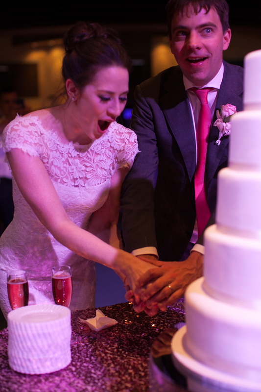 The bride's sole request was for super sugary, supermarket icing.  And the look on her face shows that we delivered! Note the pink champagne.  Photo by  Corry Arnold .