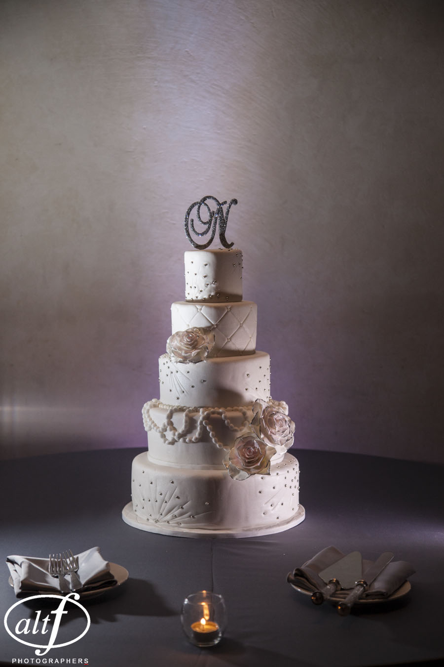 Amy & Eric Noe's Wedding Cake was soft and romantic, with pearl and crystal details taken directly from her dress design.  Wedding Cake by  Peridot Sweets .  Photo by  AltF Photography .