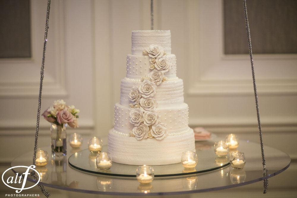 Another wedding, another cake with delicate rose detailing.  Unlike the rest, this cake was done in a flat, muted tone.  The color or a fleshy, dusty rose, Halona & Rocky Bernard wanted something classic and elegant.  Cake by  Four Seasons Las Vegas Weddings . Photo by  AltF Photography .