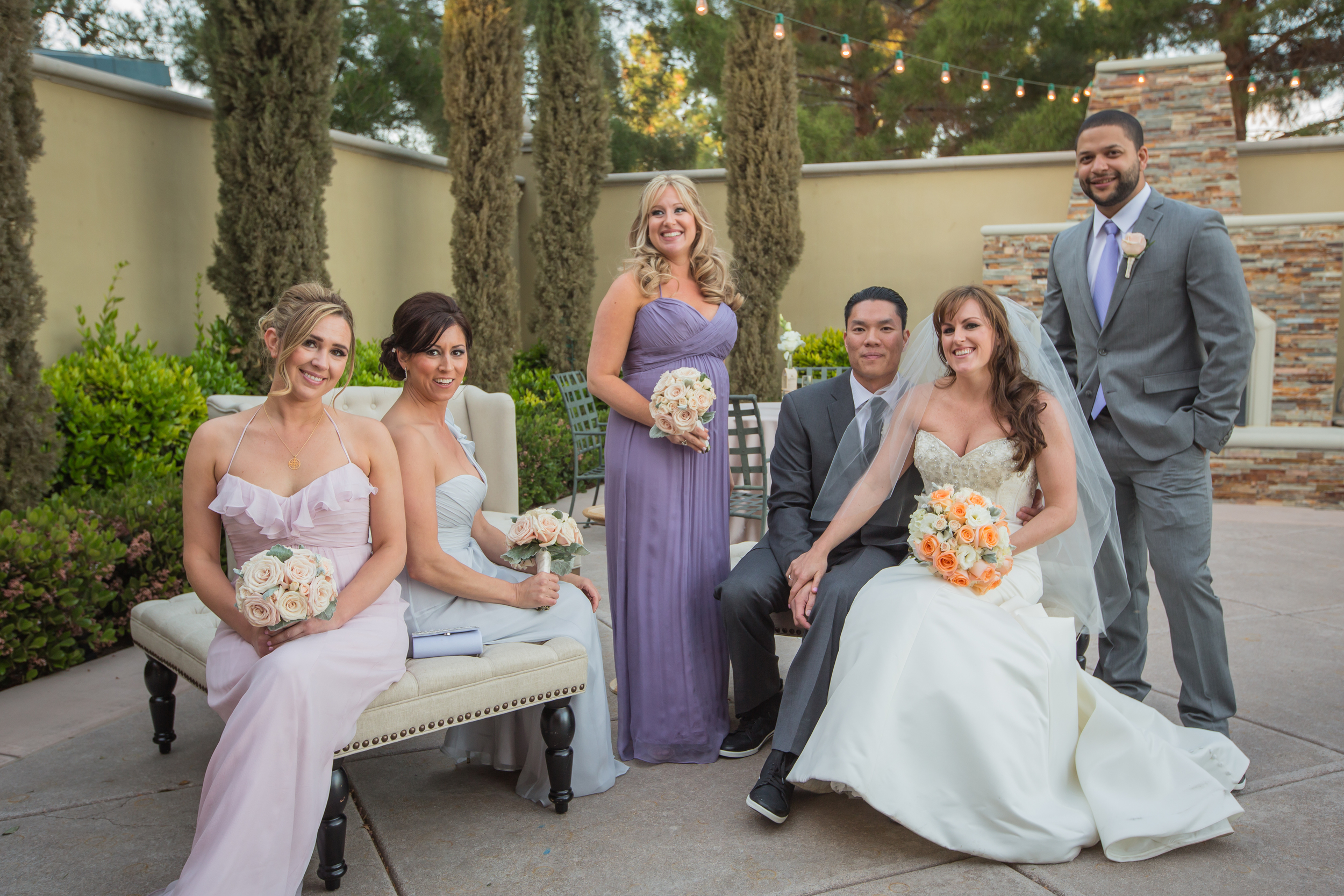 The Bridal Party.  Bridesmaids in shades of sorbet by Bella Bridesmaids.  The Groom and his Best Man in Vera Wang.     Las Vegas Wedding at   Siena Golf Club    |  Photography by   Ella Gagiano    | Floral and Decor by  Naakiti Floral   |  Las Wedding Planner   Andrea Eppolito