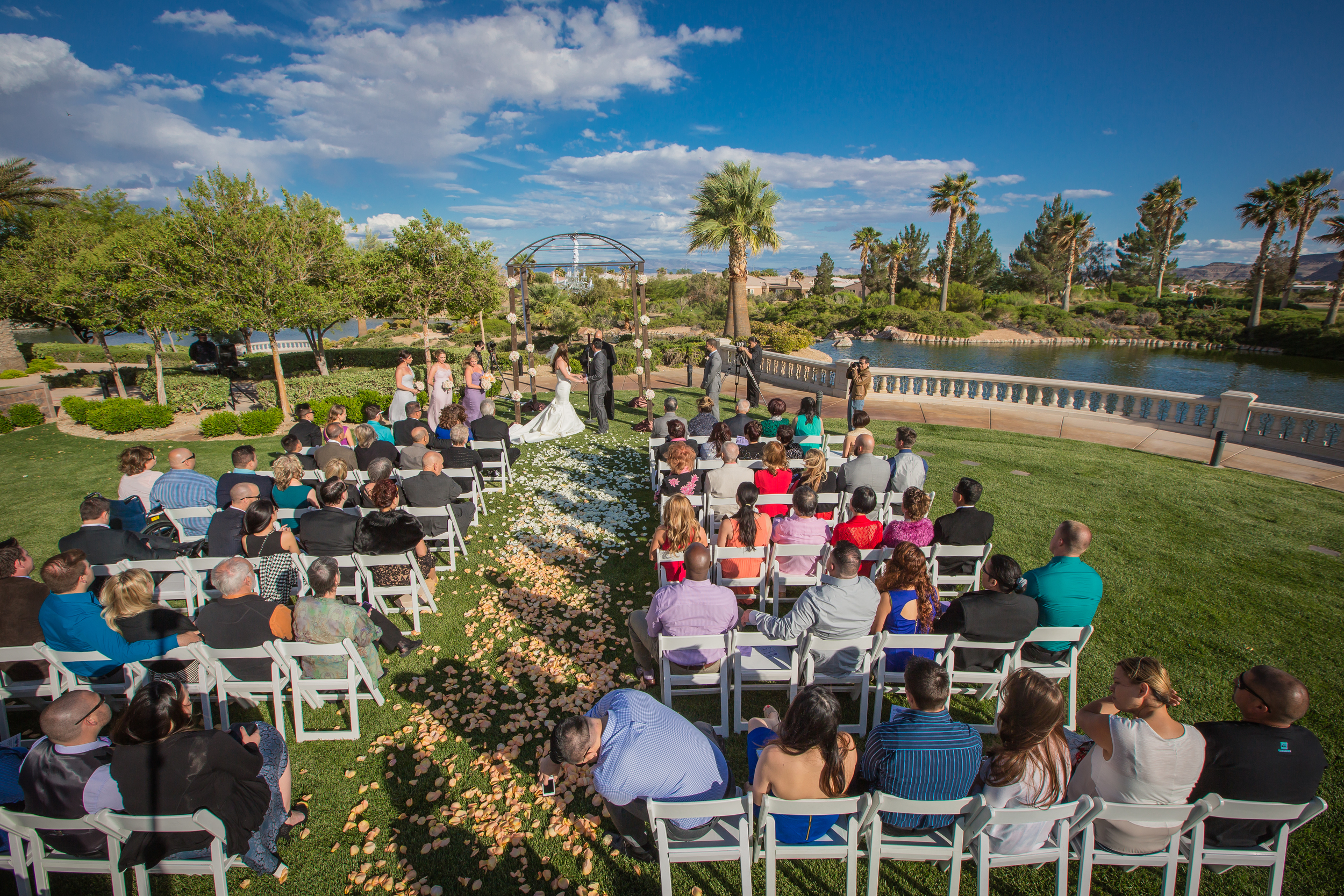 An arial view of the lakeside ceremony.    Las Vegas Wedding at  Siena Golf Club   |  Photography by  Ella Gagiano   | Floral and Decor by  Naakiti Floral   |  Las Wedding Planner  Andrea Eppolito