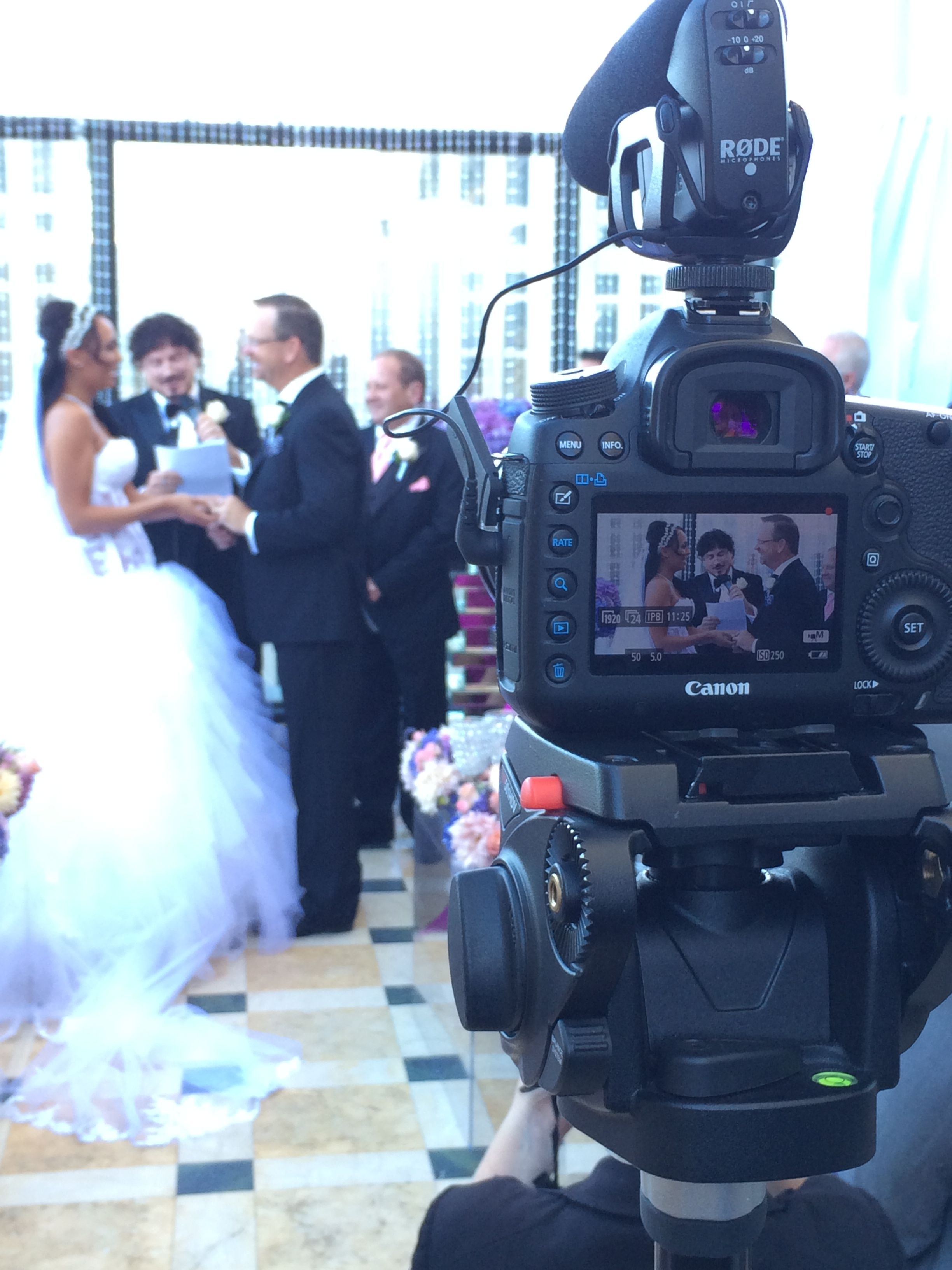 Truly behind the scenes of Lighten FIlm's lens.   Las Vegas Wedding Planner:  Andrea Eppolito Events  | Las Vegas Wedding Venue:   Caesars Palace  | Floral and Decor:   Naakiti Floral   | Wedding Gown:  Pnina Torna  i | Behind the Scenes Photos:   Andrea Eppolito