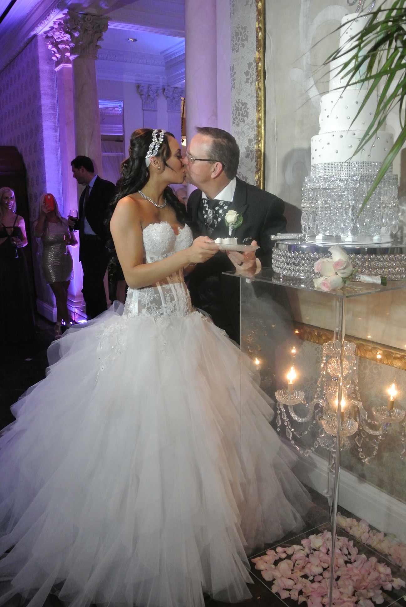 Cake Cutting and Kisses.   Las Vegas Wedding Planner:  Andrea Eppolito Events  | Las Vegas Wedding Venue:   Caesars Palace  | Floral and Decor:   Naakiti Floral & Sit On This  | Wedding Gown:  Pnina Torna  i | Wedding Cake: Peridot Sweets | Behind the Scenes Photos:   Andrea Eppolito