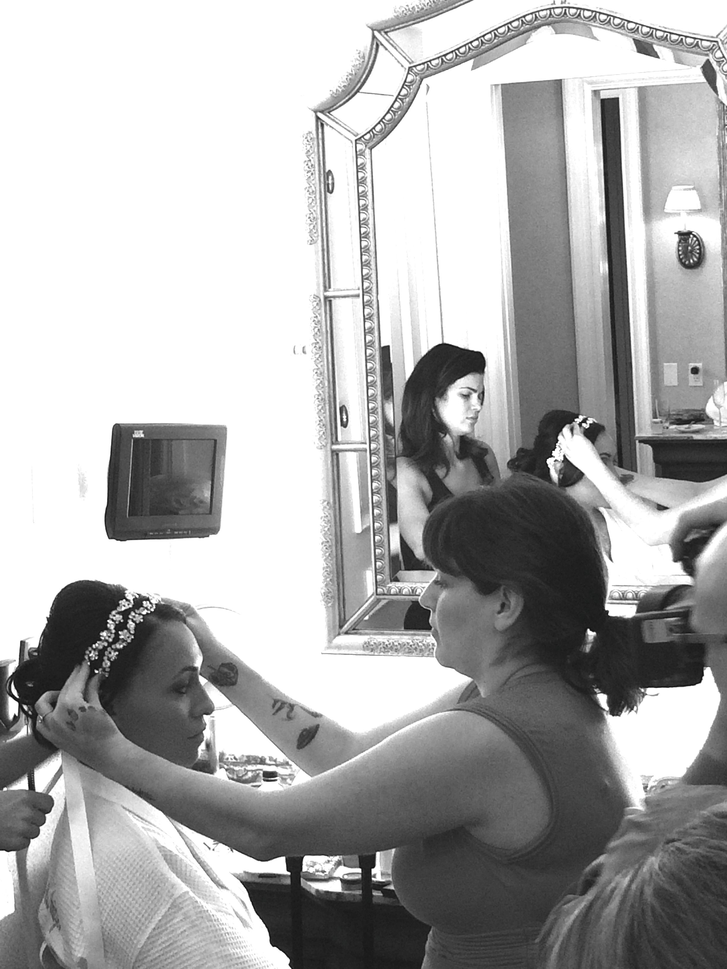 Your Beauty Call  owners Janine Cali and LaVey Kindred set bride Megan's custom hair jewelry before her maid of honor helped set her  Pnina Torna i Veil.   Las Vegas Wedding Planner:  Andrea Eppolito Events  | Las Vegas Wedding Venue:   Caesars Palace  | Floral and Decor:   Naakiti Floral & Sit On This  | Behind the Scenes Photos:   Andrea Eppolito
