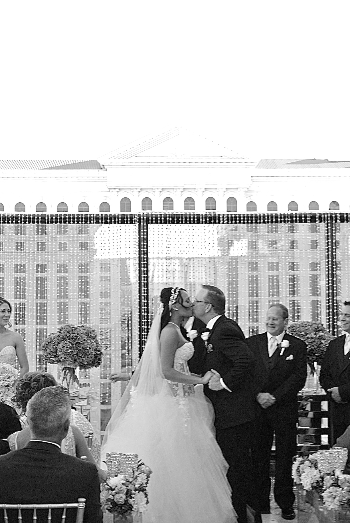 You may kiss the bride!   Las Vegas Wedding Planner:  Andrea Eppolito Events  | Las Vegas Wedding Venue:   Caesars Palace  | Floral and Decor:   Naakiti Floral & Sit On This  | Wedding Gown:  Pnina Torna  i | Behind the Scenes Photos:   Andrea Eppolito