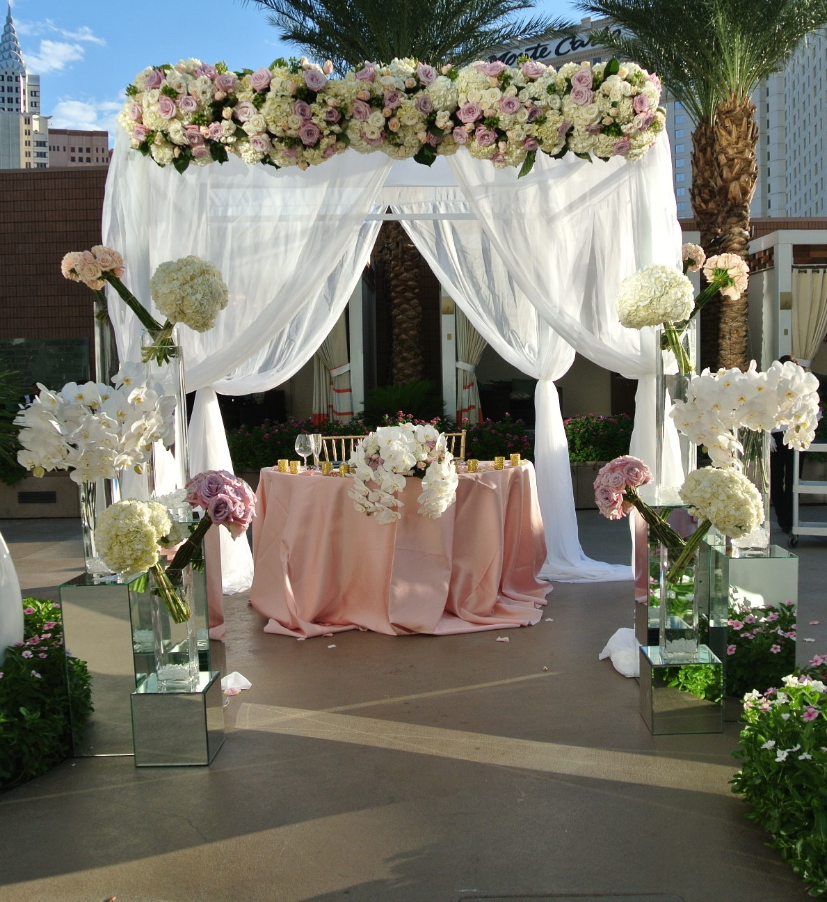The ceremony gazebo was transformed into a sweetheart table and lovers retreat for the bride and groom, allowing them to spend some time alone together during dinner and the reception.   Las Vegas Wedding Planner:    Andrea Eppolito Events    |  Wedding Venue:    Mandarin Oriental Las Vegas    |  Decor:    Naakiti Floral
