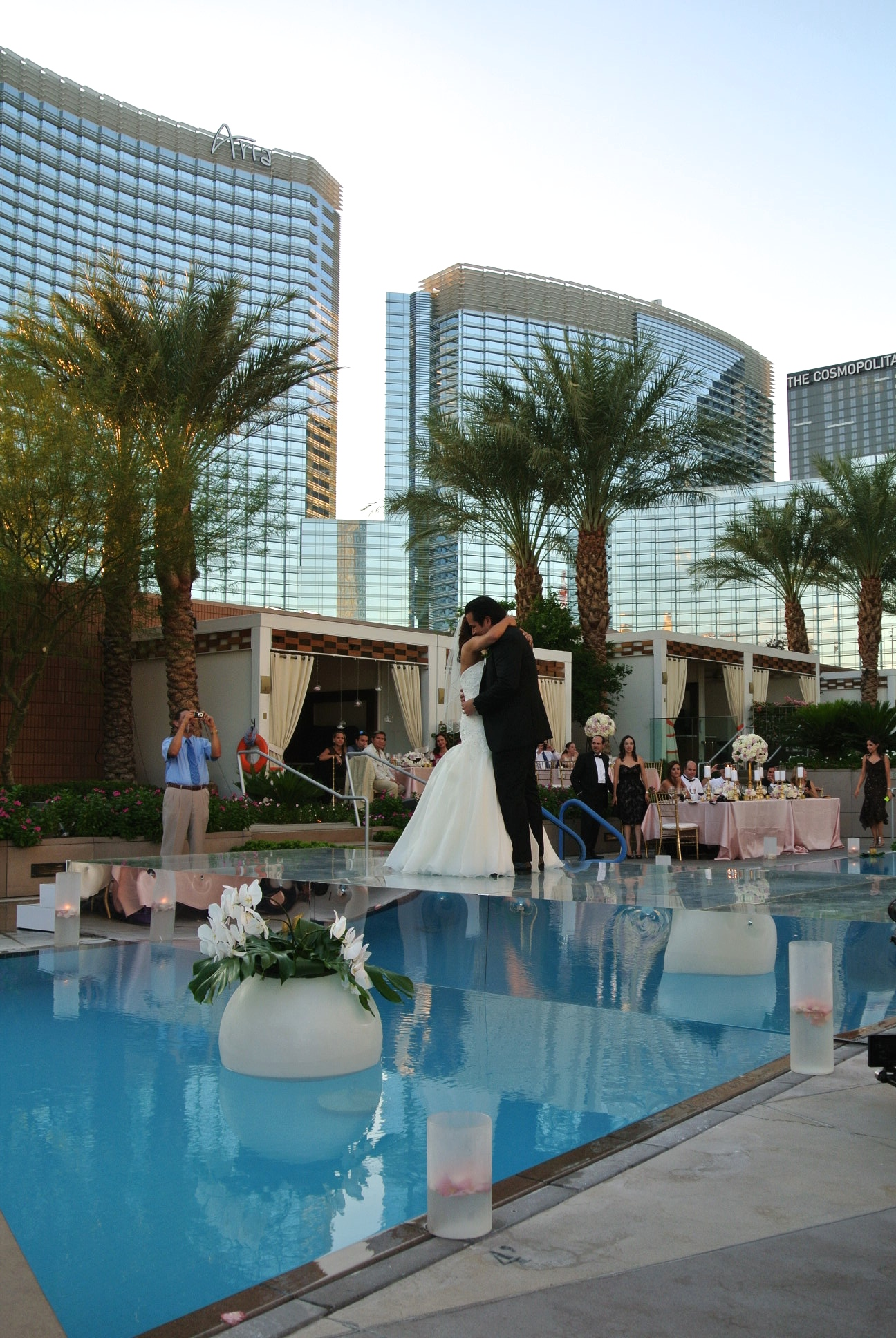 The bride and groom were announced, and took their place on the glass topped bridge, enjoying their first dance as husband and wife surrounded by friends, family, florals, and the stunning Vegas skyline.   Las Vegas Wedding Planner:    Andrea Eppolito Events    |  Wedding Venue:    Mandarin Oriental Las Vegas