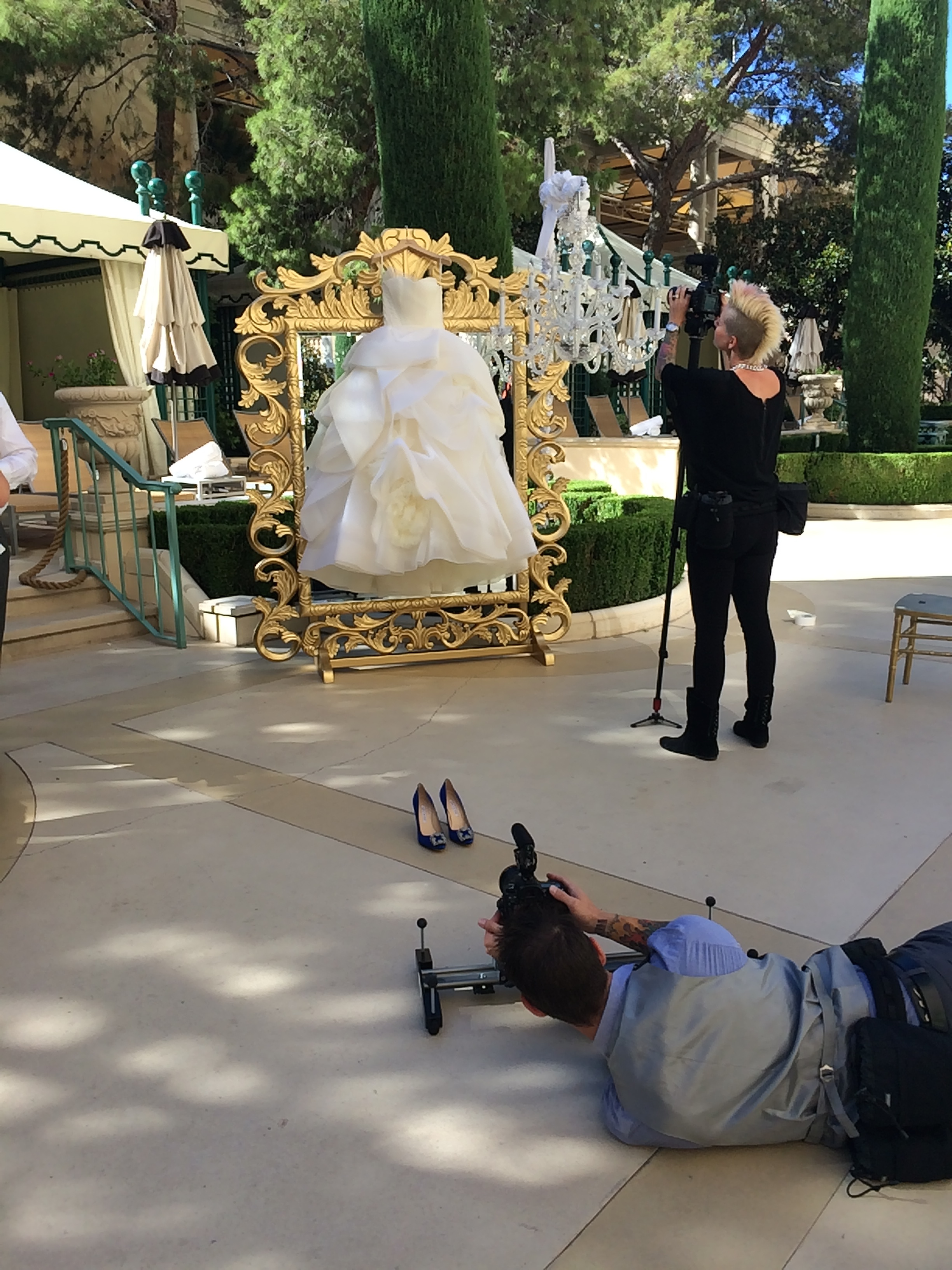 We hung the bride's Vera Wang Dress outside on a mirror because, well, we could! Las Vegas Wedding Planner Andrea Eppolito  |  Wedding at Bellagio Las Vegas