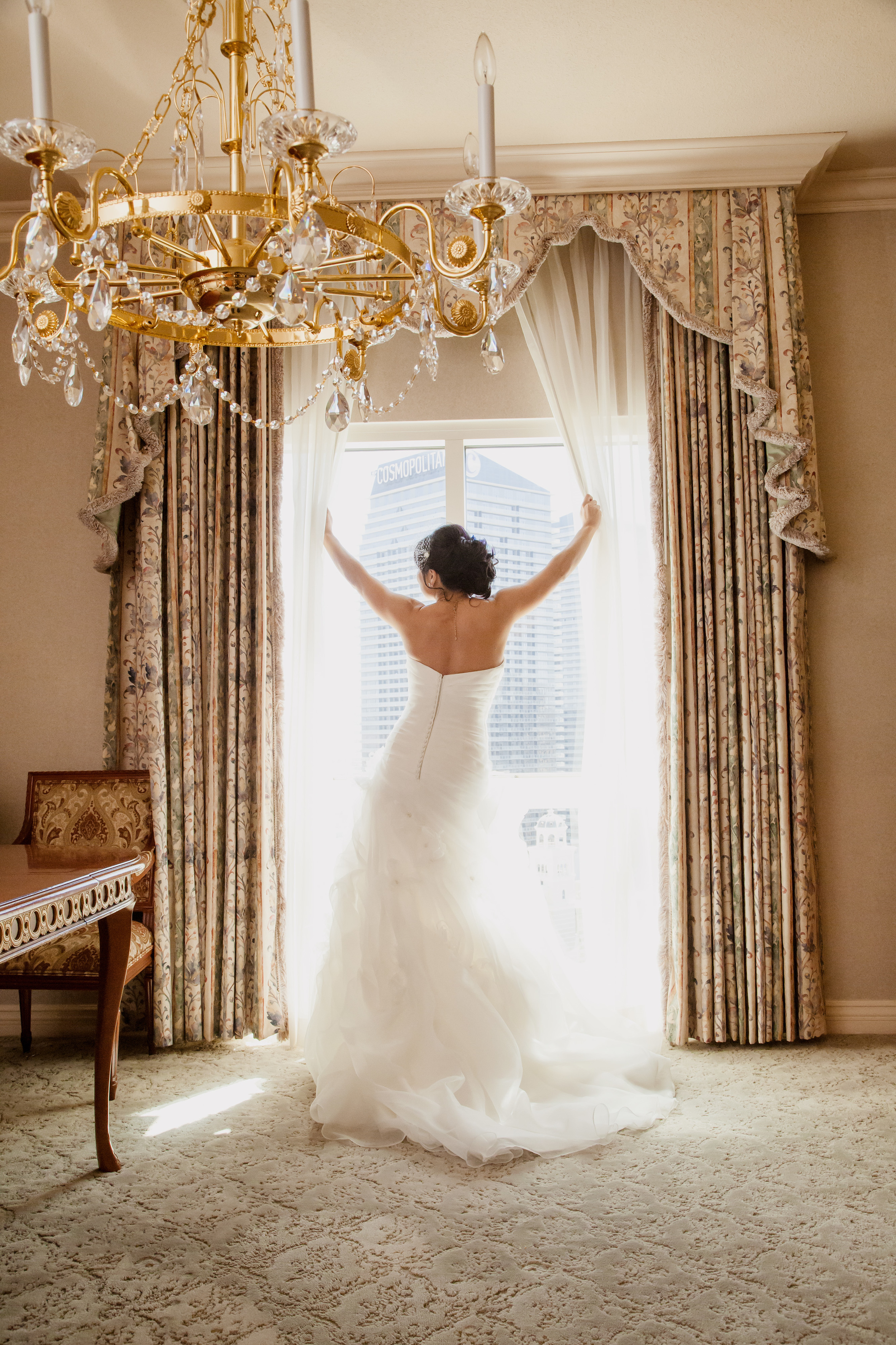 Always a classic image of the bride pulling back the drapes of a window.