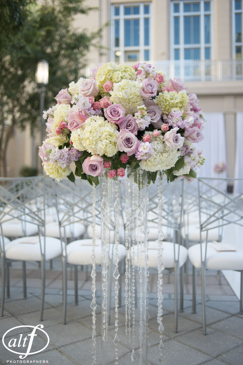 Wedding Aisle pew markers with lavender roses, white hydrangea, and crystals by Naakiti Floral for a luxury outdoor wedding.