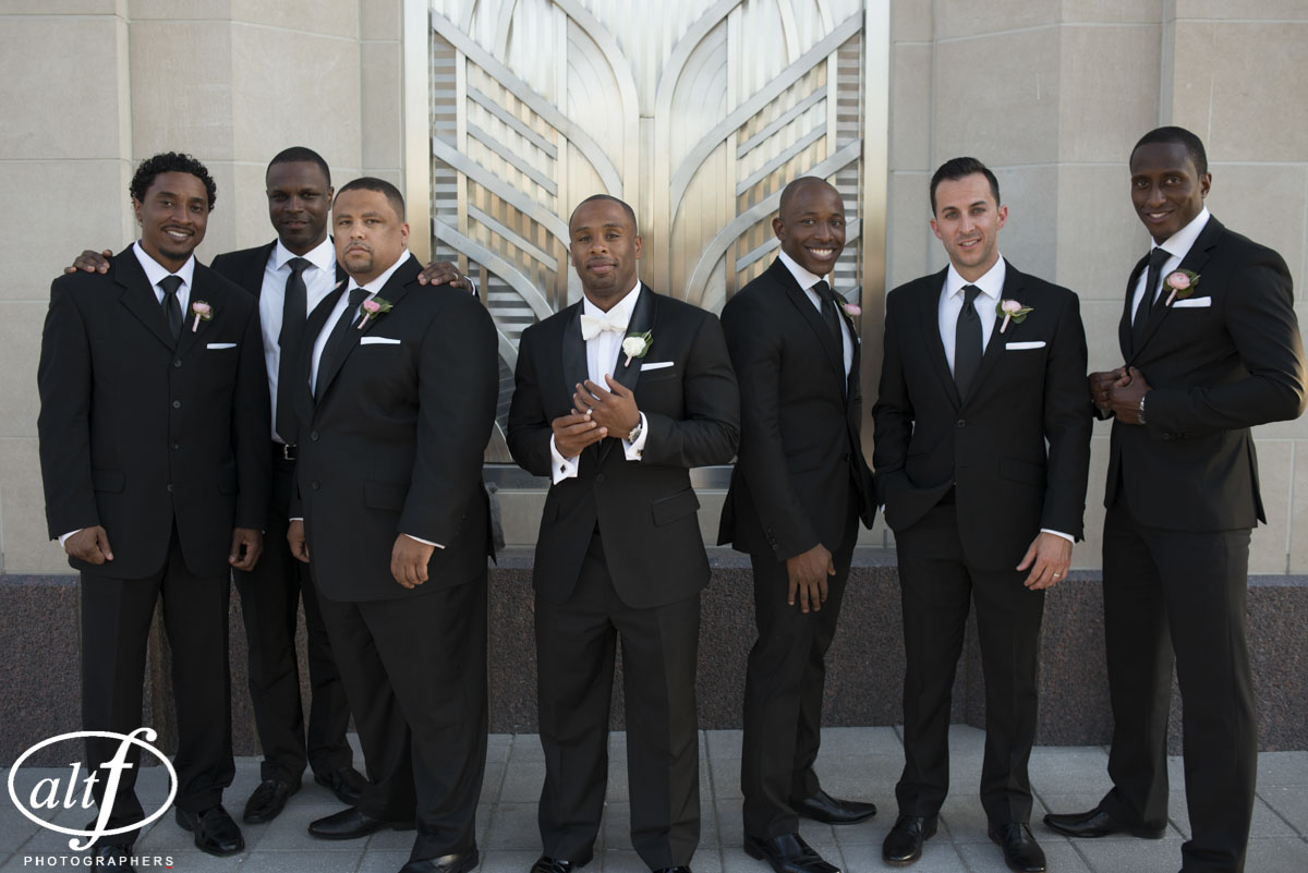 The groomsmen looked dashing in all black tuxedos.