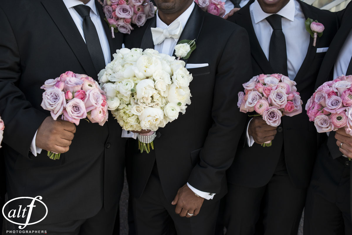 White Bridal Bouquet and Pink and Lavender Bridesmaid Bouquets by Naakiti Floral.