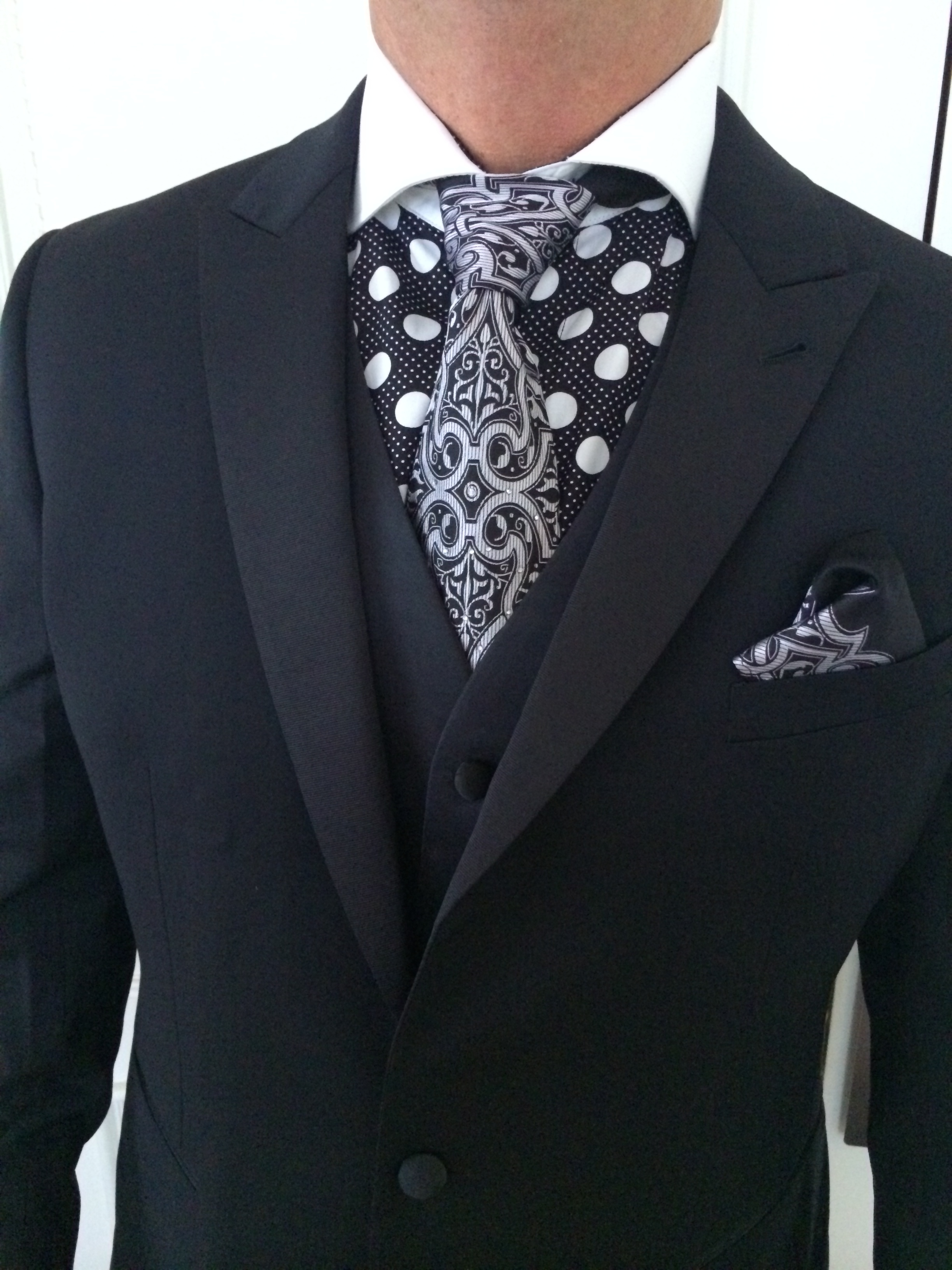 Another custom cut for the groom who wants to make a statement. Alan Bridges worked with a tailor and designer to create a combination that shouldn't have worked together, but totally did. September 2014.   Las Vegas Wedding Planner Andrea Eppolito    Photo by Andrea Eppolito.