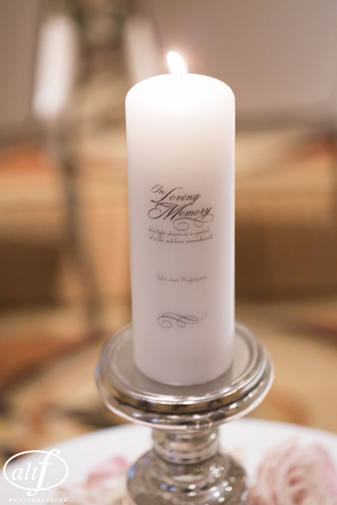 A memorial candle stood for those too far away to make it.  Las vegas Wedding Planner Andrea Eppolito