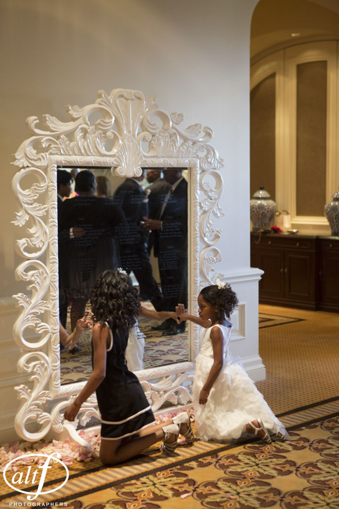 Escort cards on a mirror at the Four Seasons.  Las Vegas Wedding Planner Andrea Eppolito.