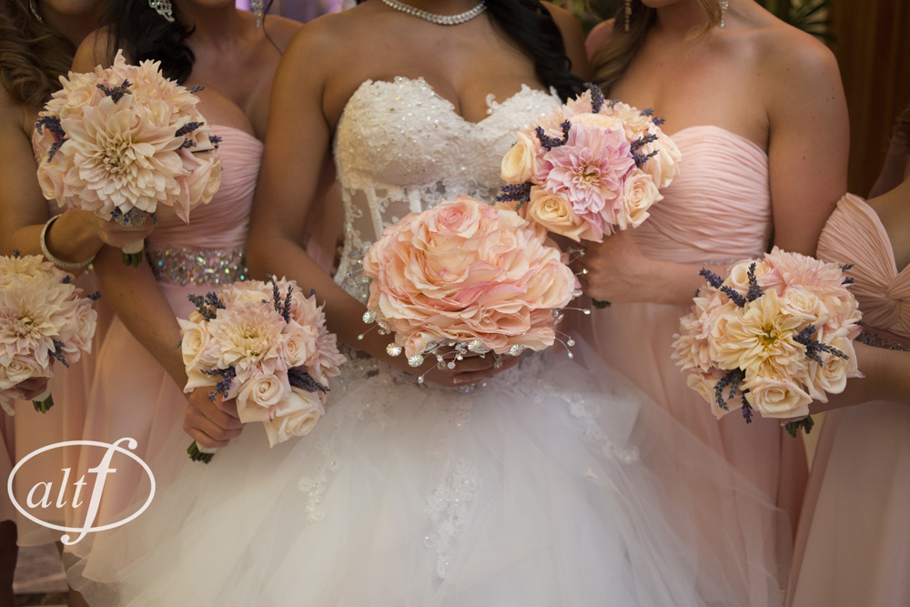 The bride's bouquet was made of over 3 dozen roses, and had a ring of crystals all around it.      Las Vegas Wedding Planner Andrea Eppolito  |    Venue:  Caesars Palace  |  Decor by Naakiti Floral
