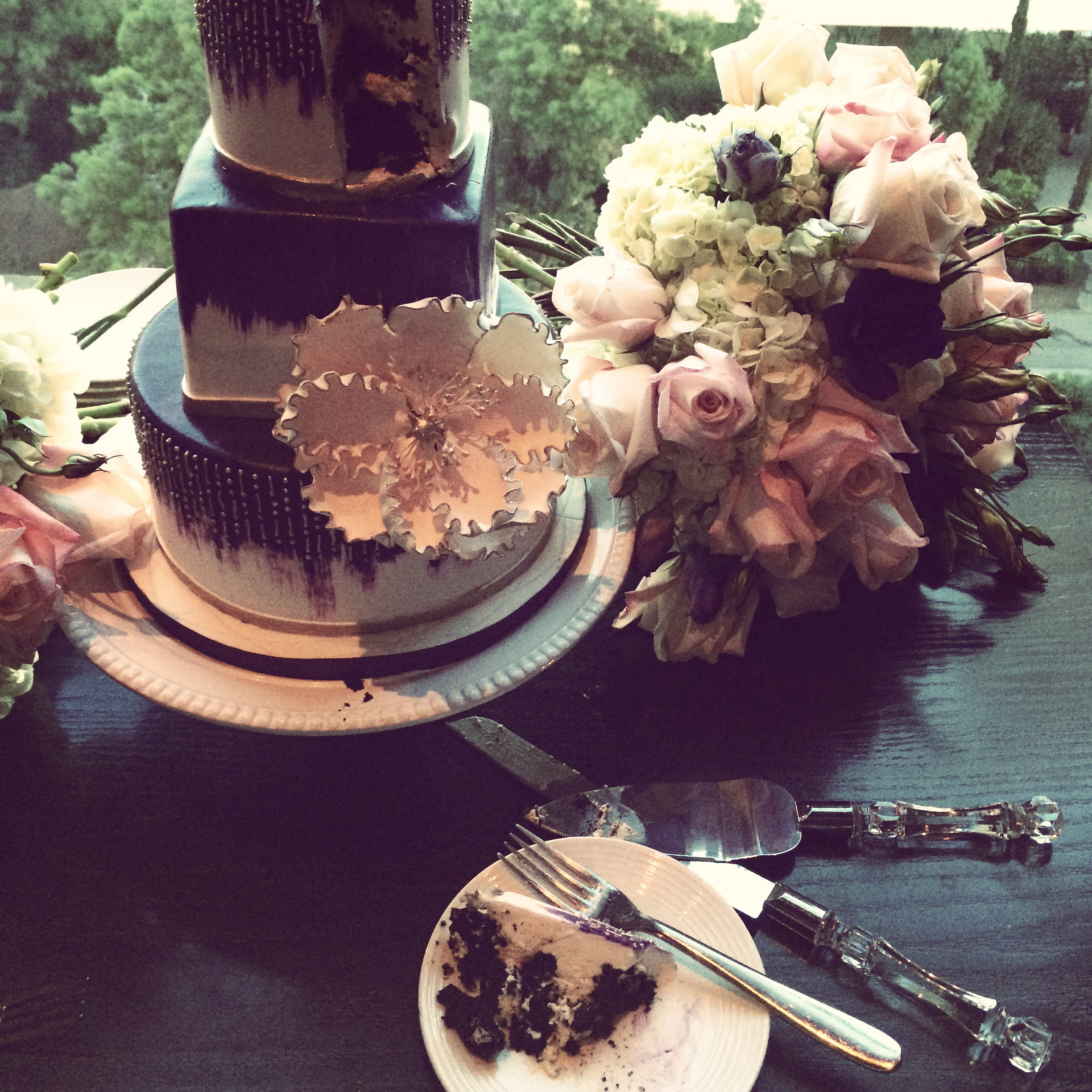 This artistic purple and ivory wedding cake was crafted by  Peridot Sweets  for a last minute wedding that popped up last weekend.  The amazing couple decided to elope with only immediate family, and wanted a cake that was fun and dramatic.  I bet we see more bold colors and dramatic design in the year to come!  Photo by  Andrea Eppolito .