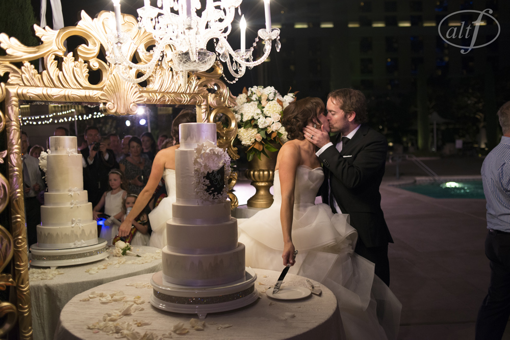 When the bride and groom cut their cake, the mirror reflected the faces of their friends and family for an intimate yet beautiful affect.  I love how everyone's emotions are perfectly captured and pulled in, with the cake holding it's own as a showpiece against the bride's Vera Wang gown.   Photo by   Alt F Photography  .