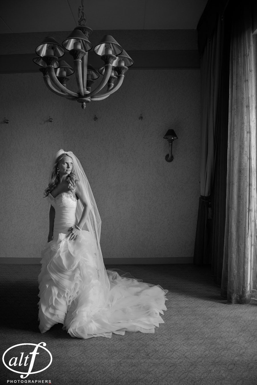 The asymmetrical waist of the gown hit the bride higher on one side than the other, keeping the eye moving, andenhancing her curves.  Amy Noe. April 2014.   Photo by  Alt F Photography  .