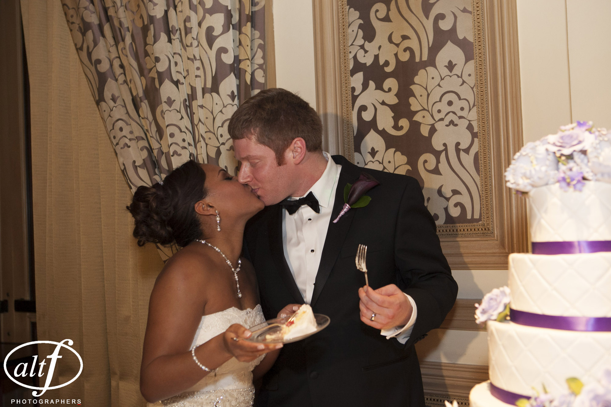 Cutting the wedding cake and kisses.Las Vegas Wedding Planner Andrea Eppolito   Wedding at Bellagio   Photo by Alt F