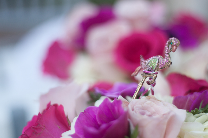 Crystal Flamingo broaches accented all of the florals in a nod to the venue.   Las Vegas Wedding Planner Andrea Eppolito Events  |  Photo by Corry Arnold  |  Vintage Poolside Wedding at The Flamingo