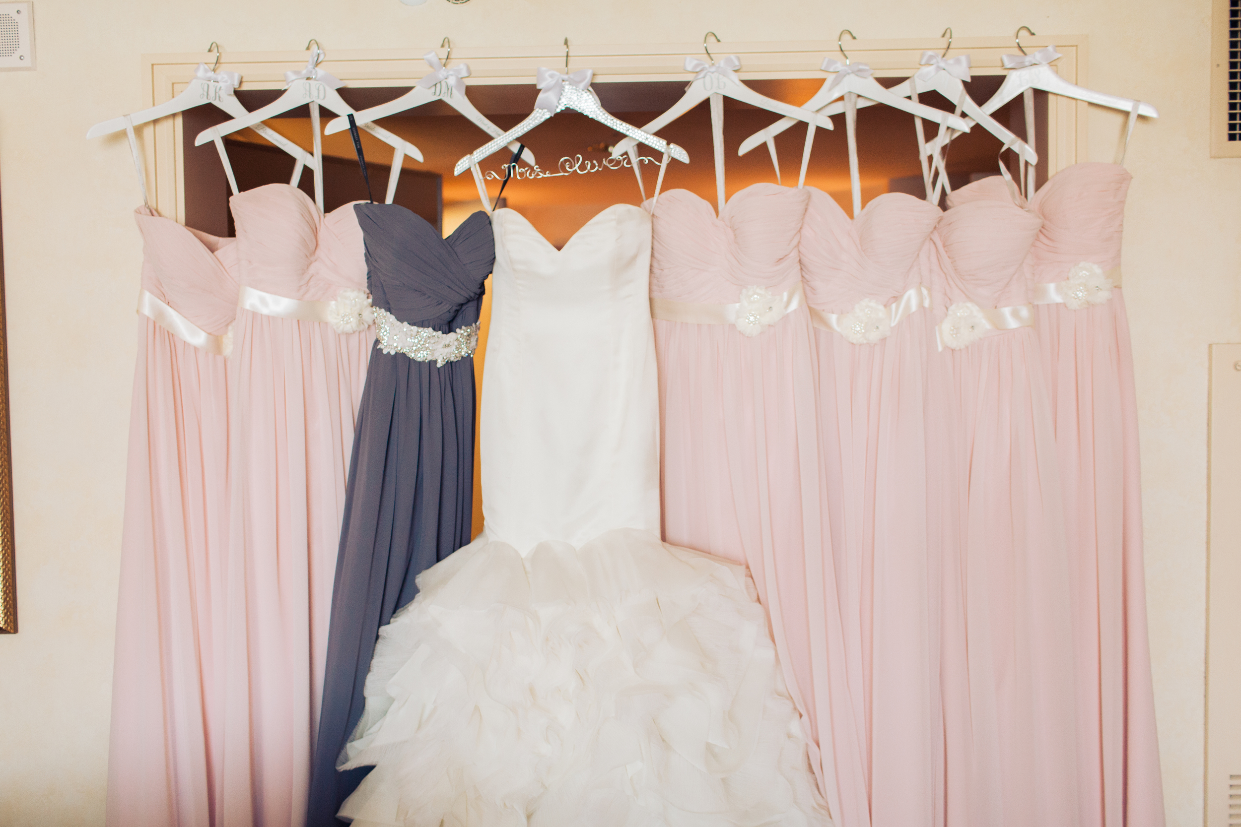 Bridesmaids wore light pink gowns, with the maid of honor wore a periwinkle purple with a custom sash.    Las Vegas Wedding Planner Andrea Eppolito   Wedding at Lake Las Vegas   White and Blu  sh and Grey Wedding   Luxury Wedding Las Vegas