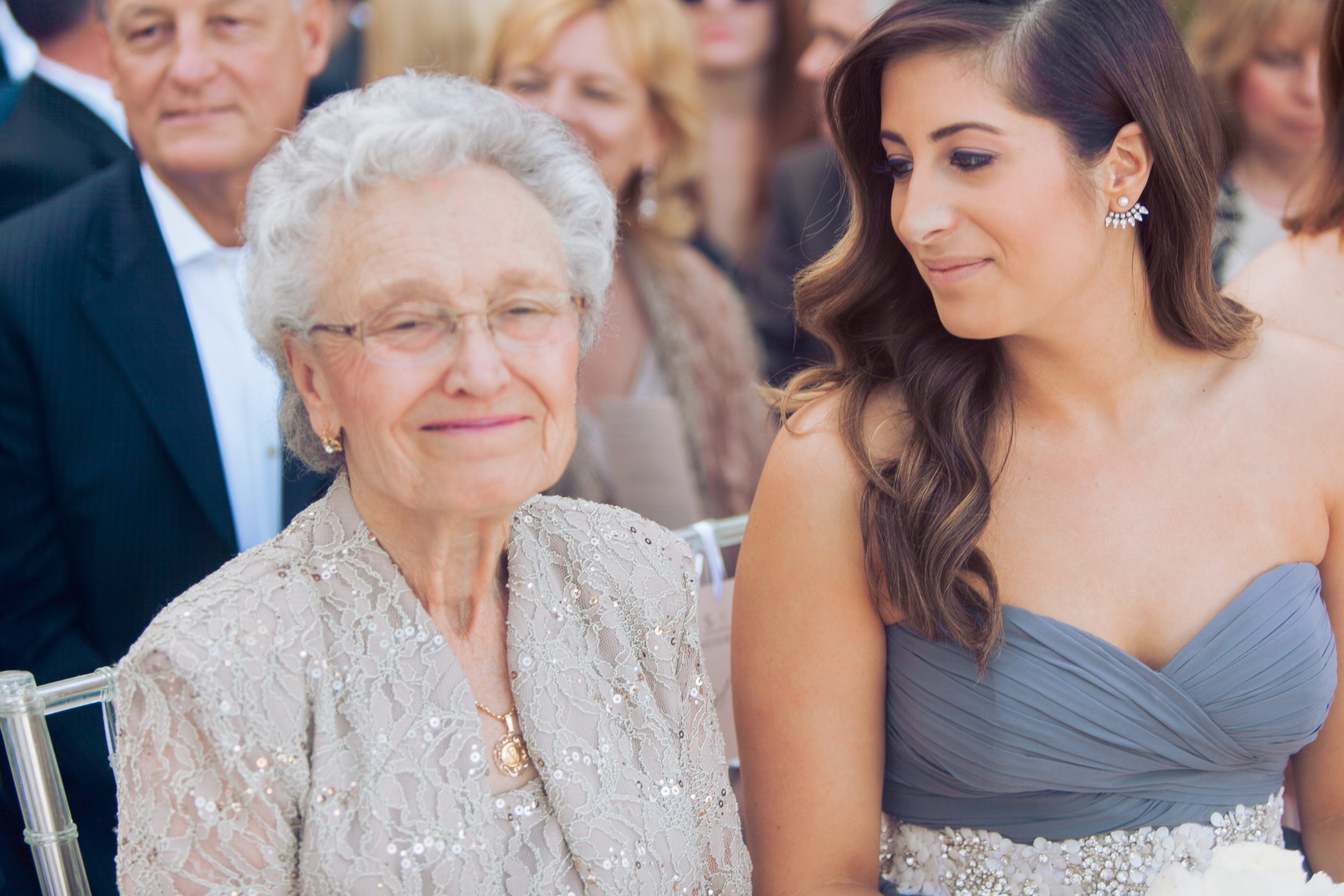 The bride's beloved grandma sat with the maid of honor and bridesmaids during the wedding ceremony.    Las Vegas Wedding Planner Andrea Eppolito   Wedding at Lake Las Vegas   White and Blu  sh and Grey Wedding   Luxury Wedding Las Vegas