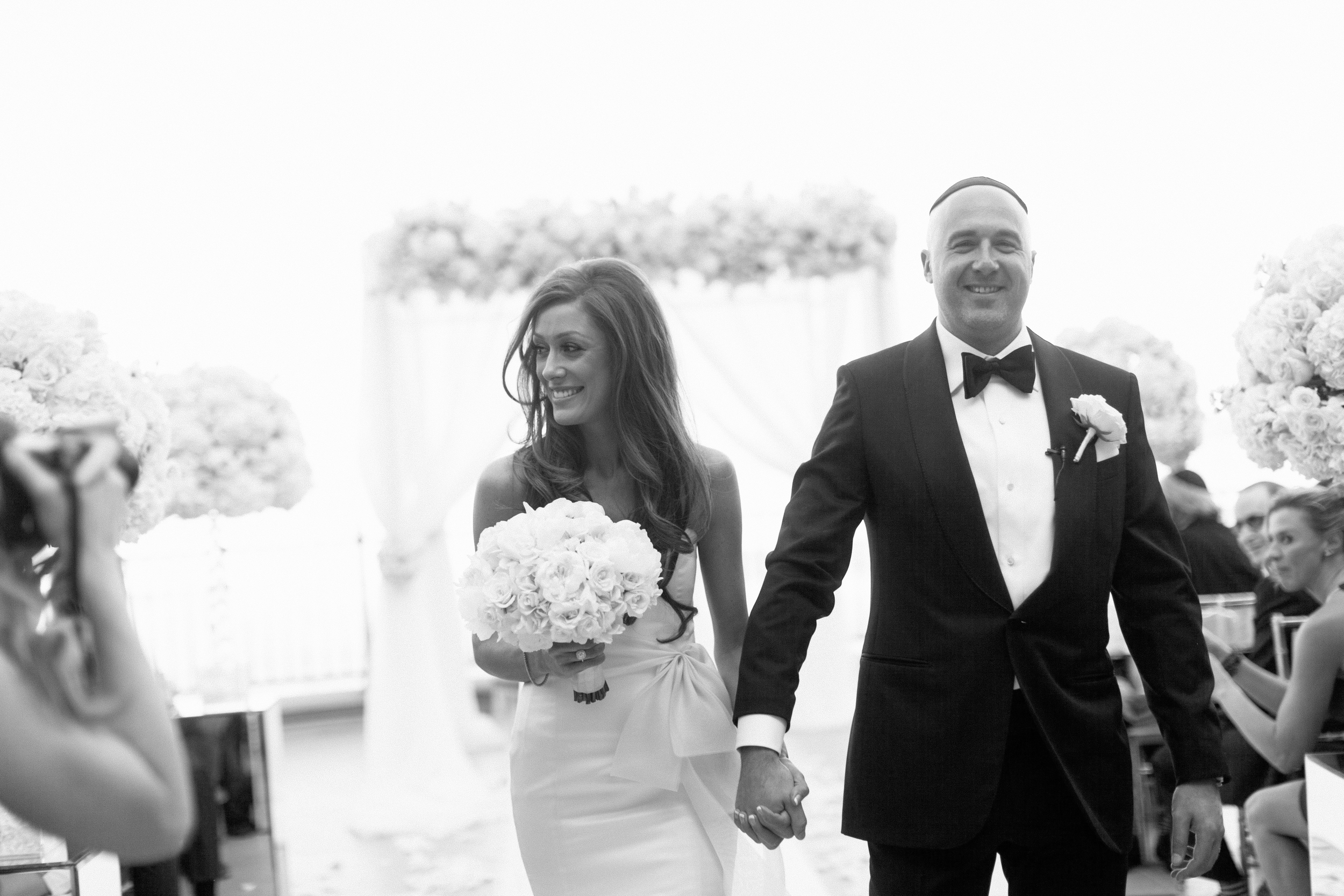 The processional moments after the bride and groom were wed.    Las Vegas Wedding Planner Andrea Eppolito   Wedding at Lake Las Vegas   White and Blu  sh and Grey Wedding   Luxury Wedding Las Vegas