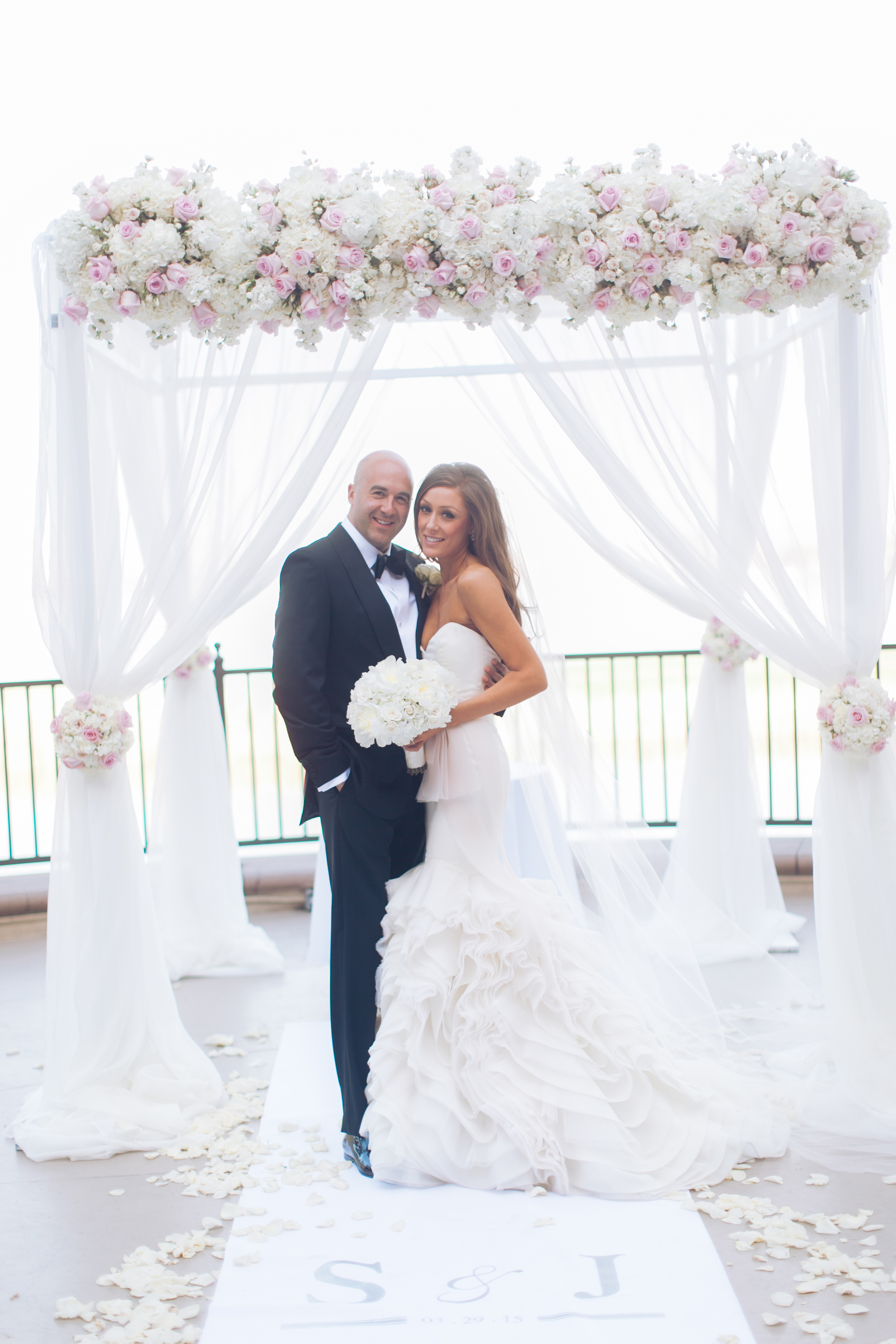 """The bride and groom hosted a beautiful, romantic ceremony at Lotus Court at The Westin Lake Las Vegas. Their aisle runner featured their """"S&J"""" monogram and wedding date.    Las Vegas Wedding Planner Andrea Eppolito   Wedding at Lake Las Vegas   White and Blu  sh and Grey Wedding   Luxury Wedding Las Vegas"""