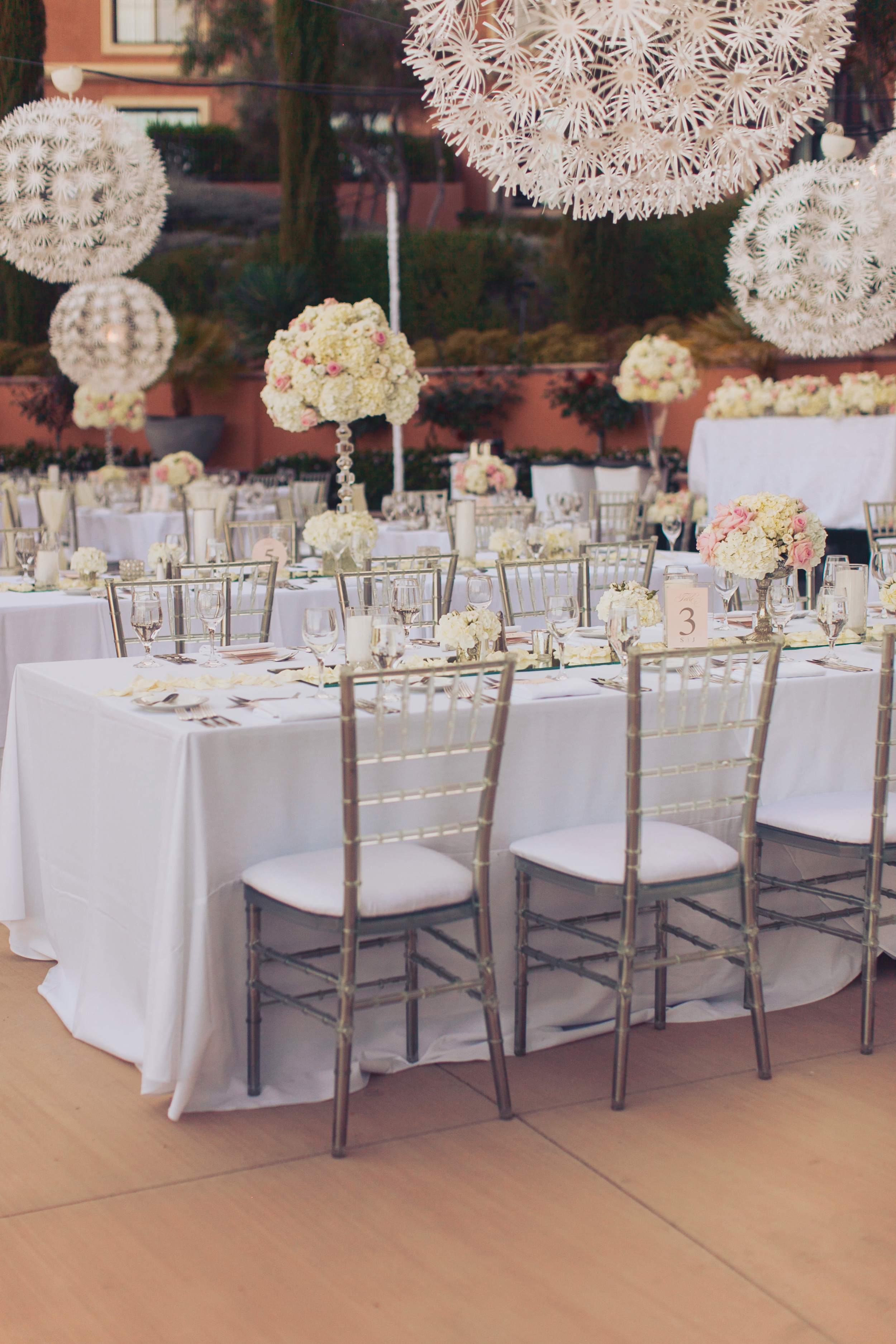 Enormous white orbs were strung above the tables, creating a magnificent lighting option that complimented the garden setting in a totally unique way. Las Vegas Wedding Planner Andrea Eppolito   Wedding at Lake Las Vegas   White and Blu  sh and Grey Wedding