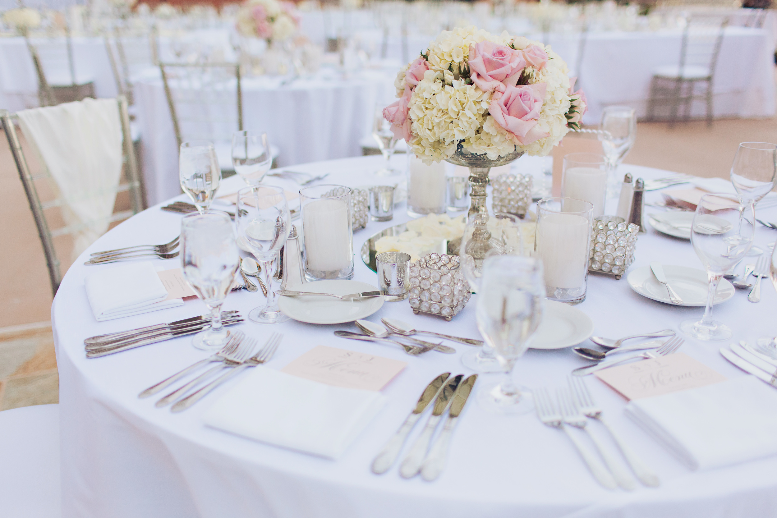 The soft pink roses were hand-opened to give a lush, full feeling to the low centerpieces and to compliment the fullness of the hydrangea.  Las Vegas Wedding Planner Andrea Eppolito   Wedding at Lake Las Vegas   White and Blu  sh and Grey Wedding