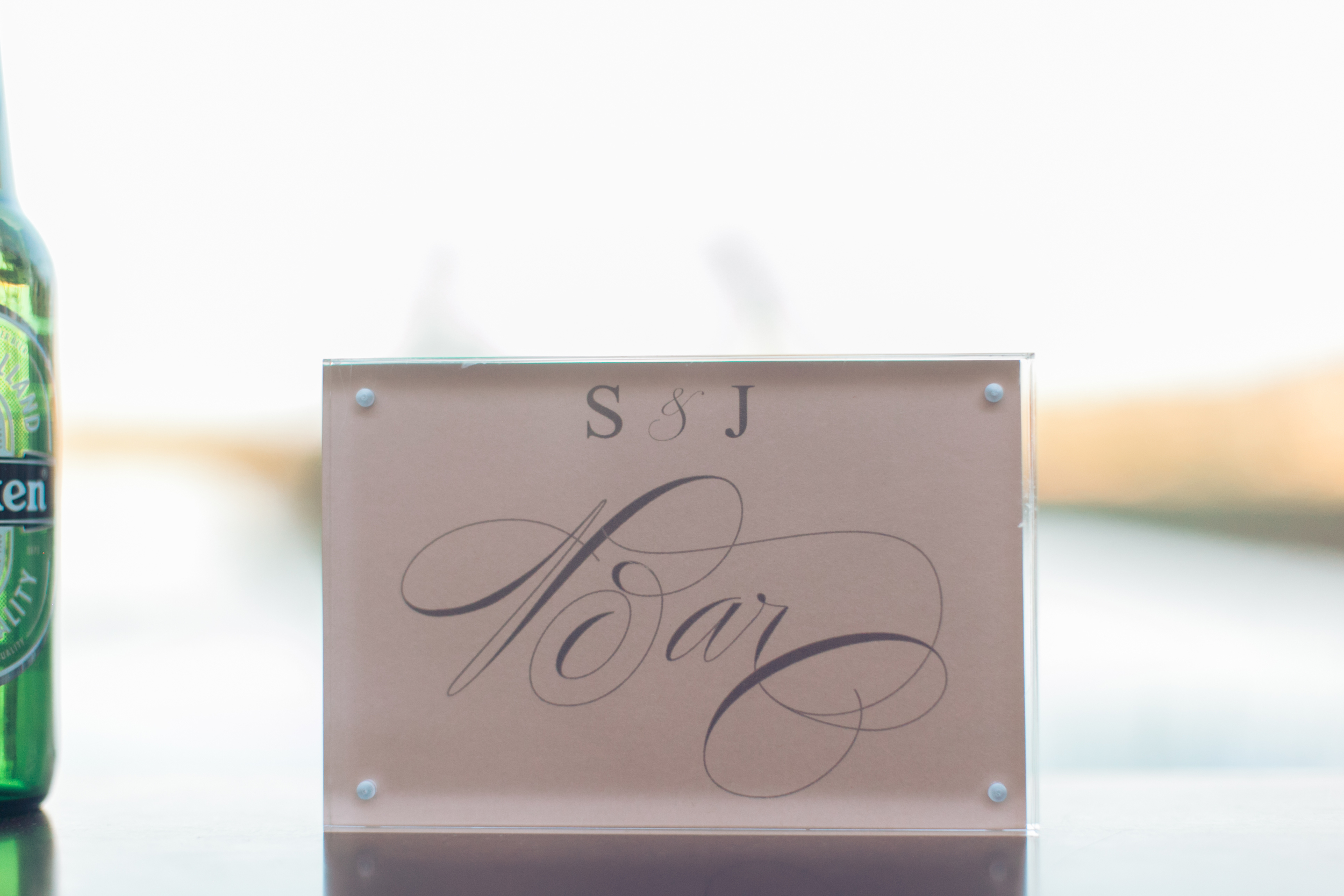 """Each bar was dressed with a small lucite sign and custom printed """"BAR"""" menu that featured the couple's monogram.    Las Vegas Wedding Planner Andrea Eppolito   Wedding at Lake Las Vegas   White and Blu  sh and Grey Wedding   Luxury Wedding Las Vegas"""