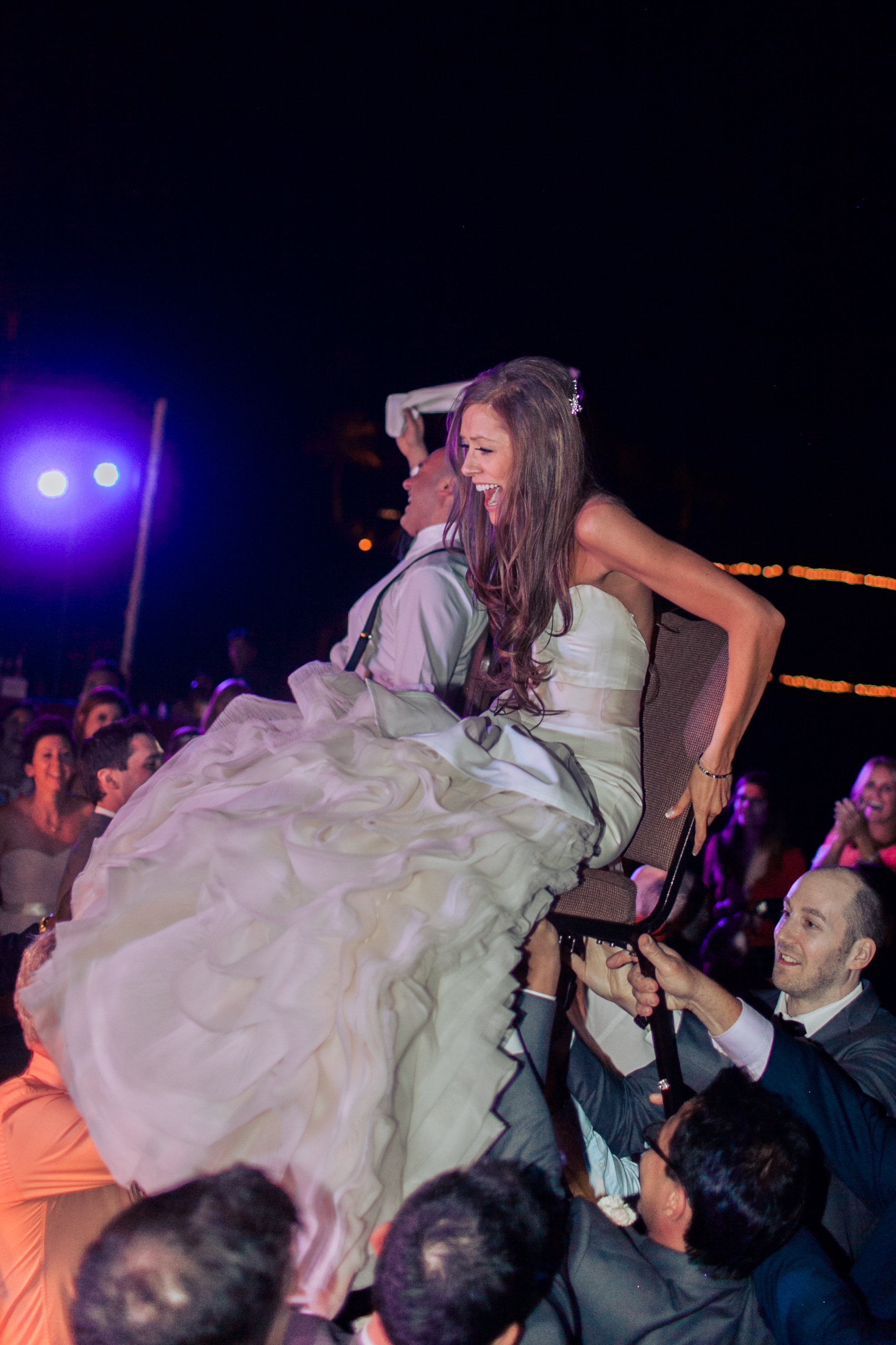 The bride and groom were lifted in their chairs for The Hora.  Stephanie Di Lallo married  Justin Oliver at a water front  wedding at The Westin Lake Las Vegas.     Las Vegas Wedding Planner Andrea Eppolito   Wedding at Lake Las Vegas   White and Blu  sh and Grey Wedding   Luxury Wedding Las Vegas