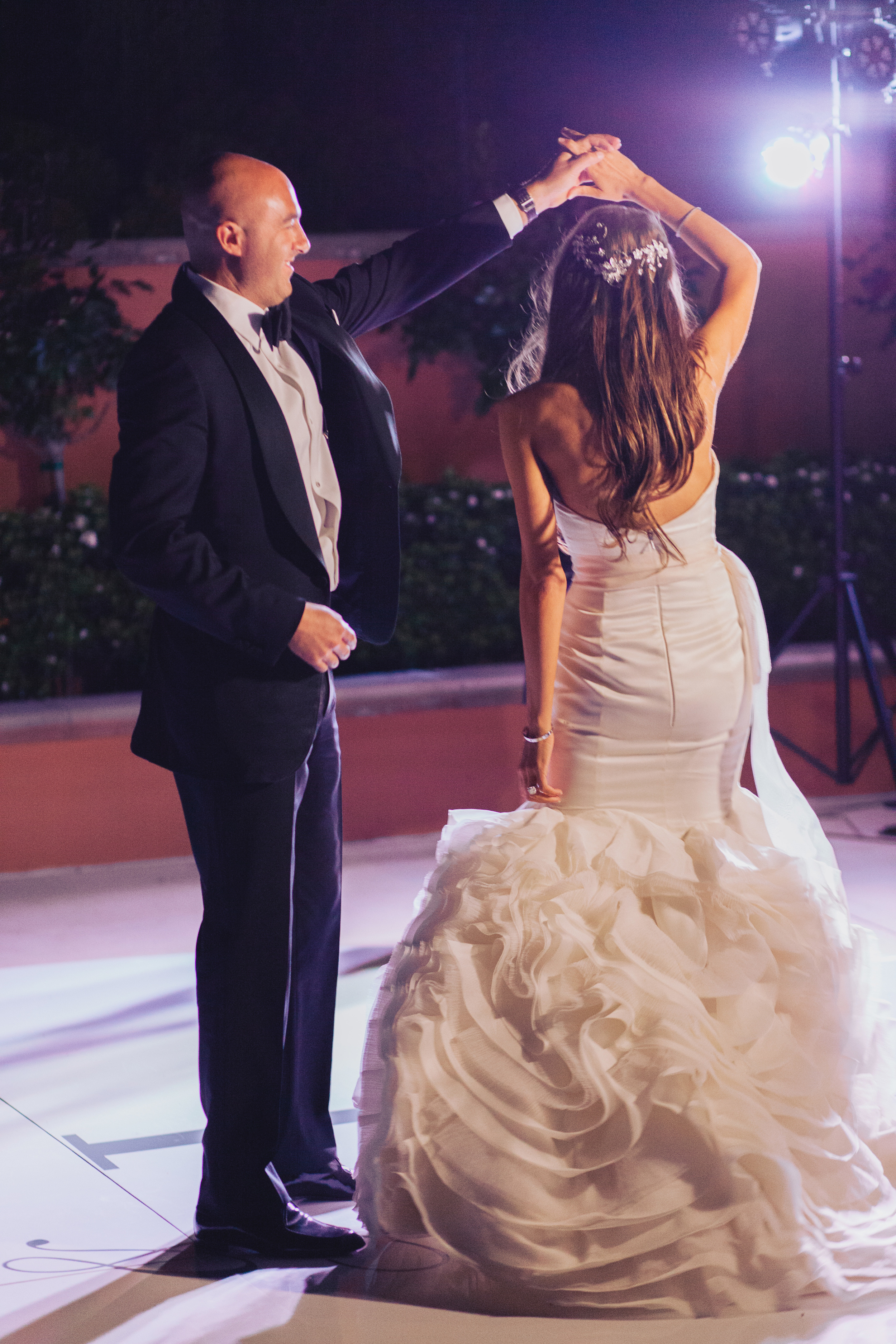 The first dance.  Stephanie Di Lallo married  Justin Oliver at a water front  wedding at The Westin Lake Las Vegas.     Las Vegas Wedding Planner Andrea Eppolito   Wedding at Lake Las Vegas   White and Blu  sh and Grey Wedding   Luxury Wedding Las Vegas