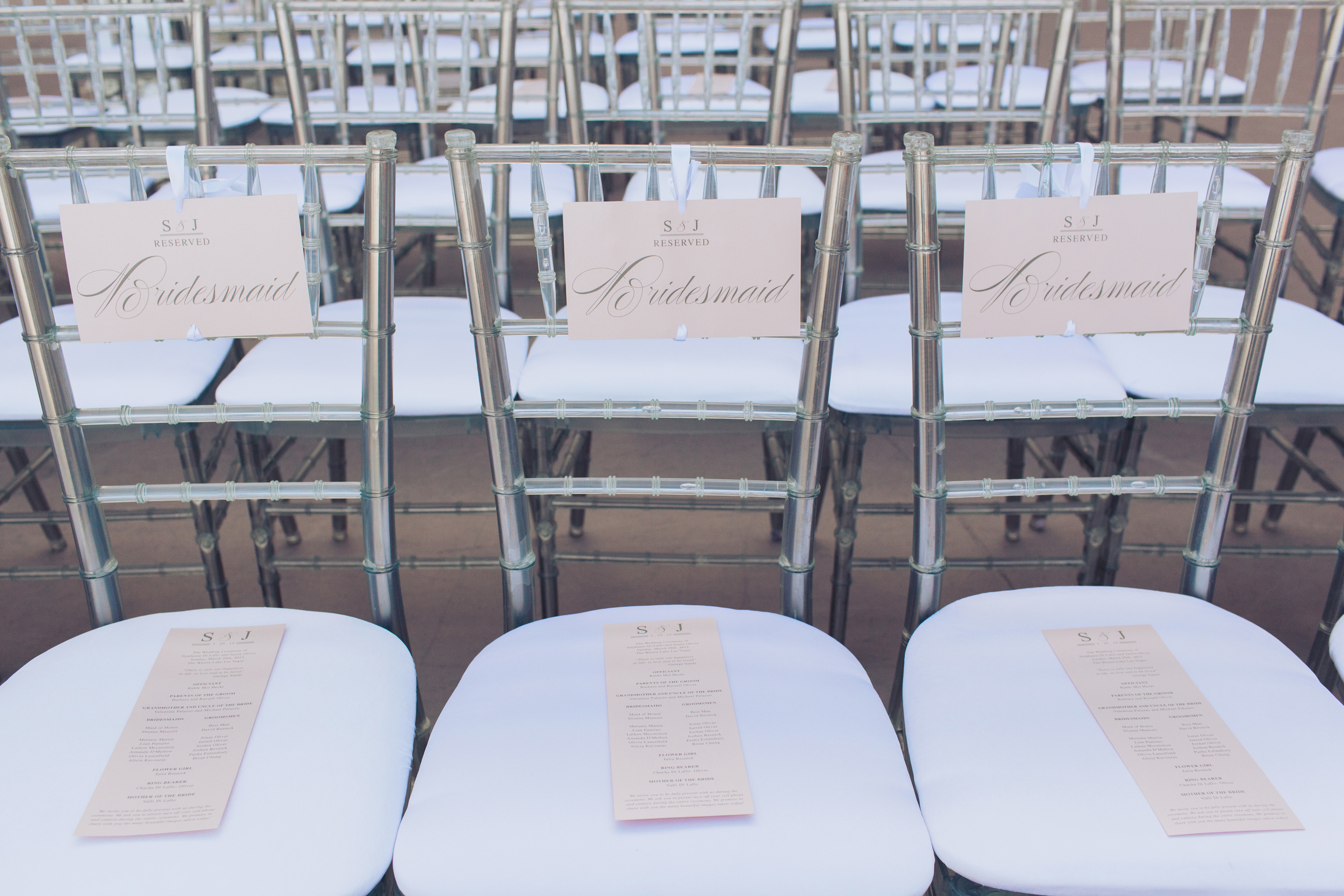 The bridal party was seated in the first row, with custom hangers and programs in blush.  Las Vegas Wedding Planner Andrea Eppolito   Wedding at Lake Las Vegas   White and Blu  sh and Grey Wedding   Luxury Wedding Las Vegas