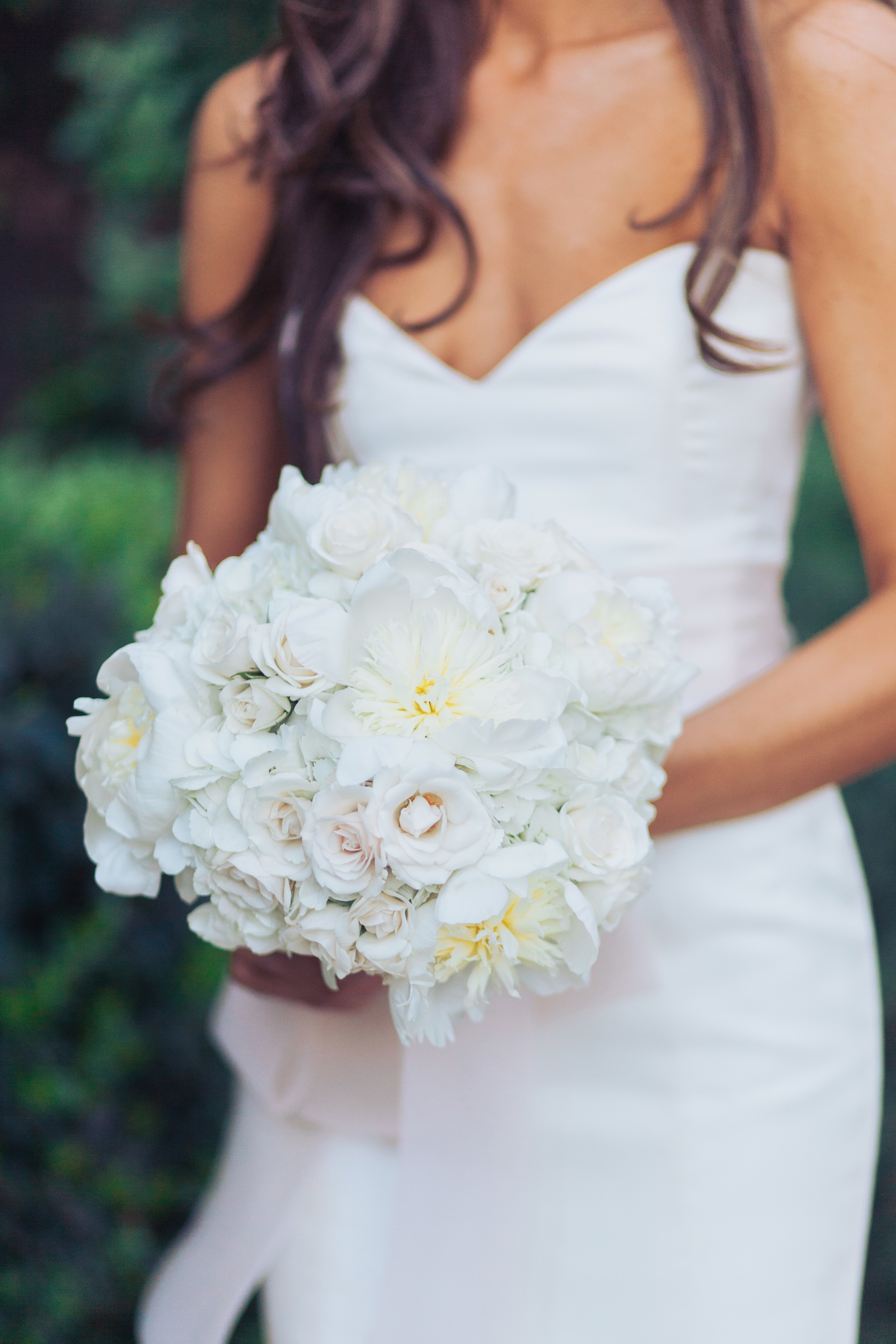 The bride's bouquet was timeless and romantic, with the softest blush, ivory, and white flowers tied into a hand held bouquet by Naakiti Floral.  Las Vegas Wedding Planner Andrea Eppolito   Wedding at Lake Las Vegas   White and Blu  sh and Grey Wedding   Luxury Wedding Las Vegas