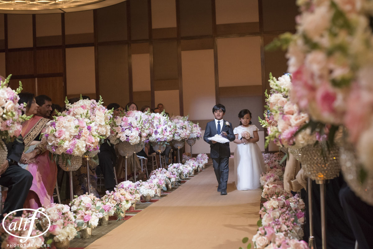 Ring bearer and flower girl at an I ndian Wedding at the Mandarin Oriental. Las Vegas Wedding Planner Andrea Eppolito. Photo by Altf.