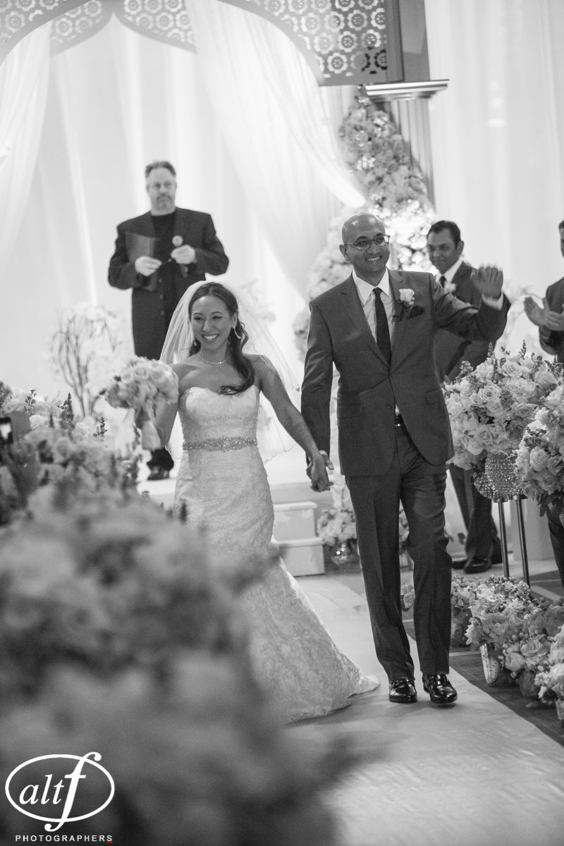 The recessional. Western and I  ndian Wedding at the Mandarin Oriental. Las Vegas Wedding Planner Andrea Eppolito. Photo by Altf.