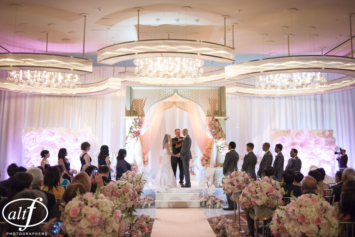 Exchanging vows in the western ceremony, which took place before the I  ndian Wedding at the Mandarin Oriental. Las Vegas Wedding Planner Andrea Eppolito. Photo by Altf.