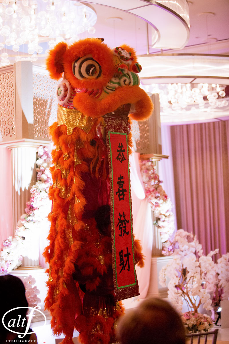A Chinese Dragon Dance at an I  ndian Wedding at the Mandarin Oriental. Las Vegas Wedding Planner Andrea Eppolito. Photo by Altf.