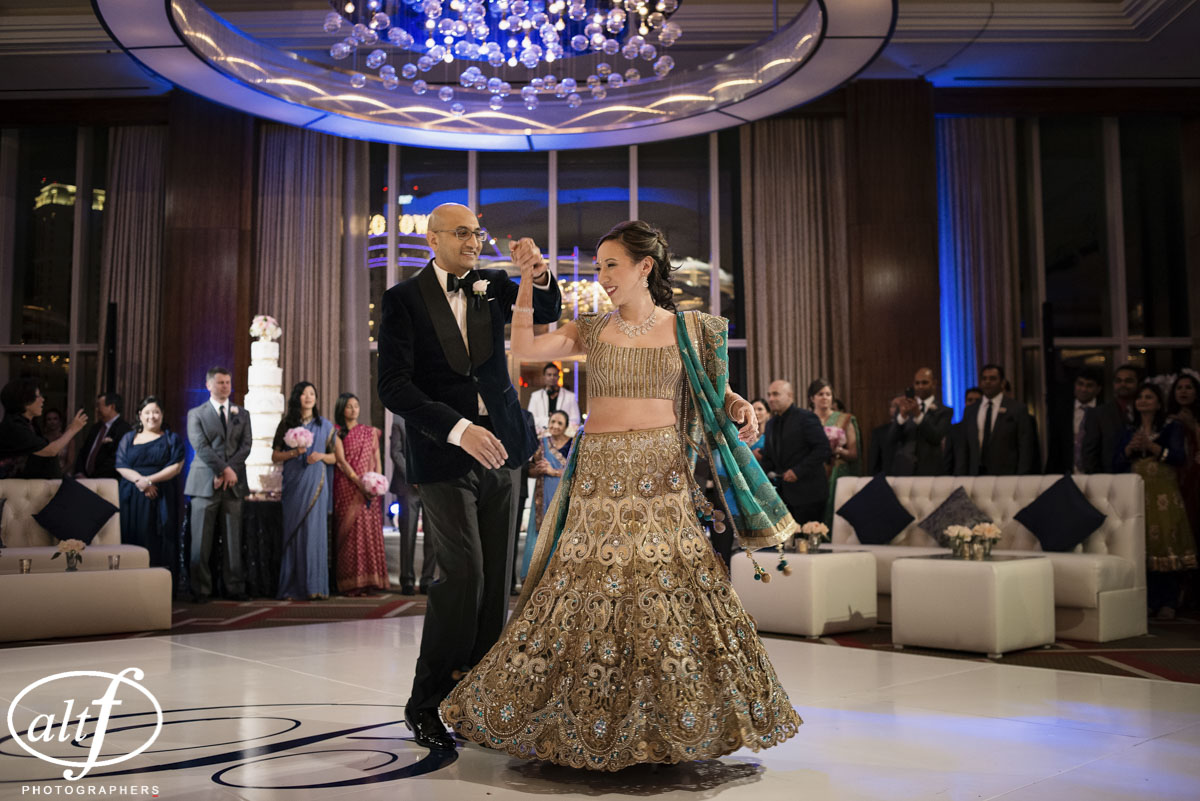 The first dance on their white monogrammed dance floor. Indian Wedding at the Mandarin Oriental. Luxury Las Vegas Wedding Planner Andrea Eppolito. Photo by Altf Photography. Floral, Decor, and Entertainment by DBD Las Vegas.