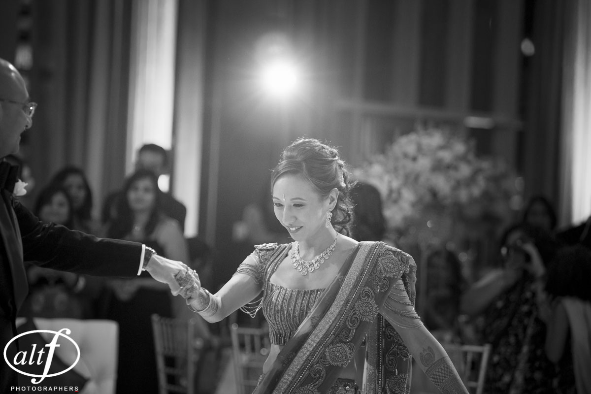 Black and White Photos of the couple's first dance.  Indian Wedding at the Mandarin Oriental. Luxury Las Vegas Wedding Planner Andrea Eppolito. Photo by Altf Photography. Floral, Decor, and Entertainment by DBD Las Vegas.