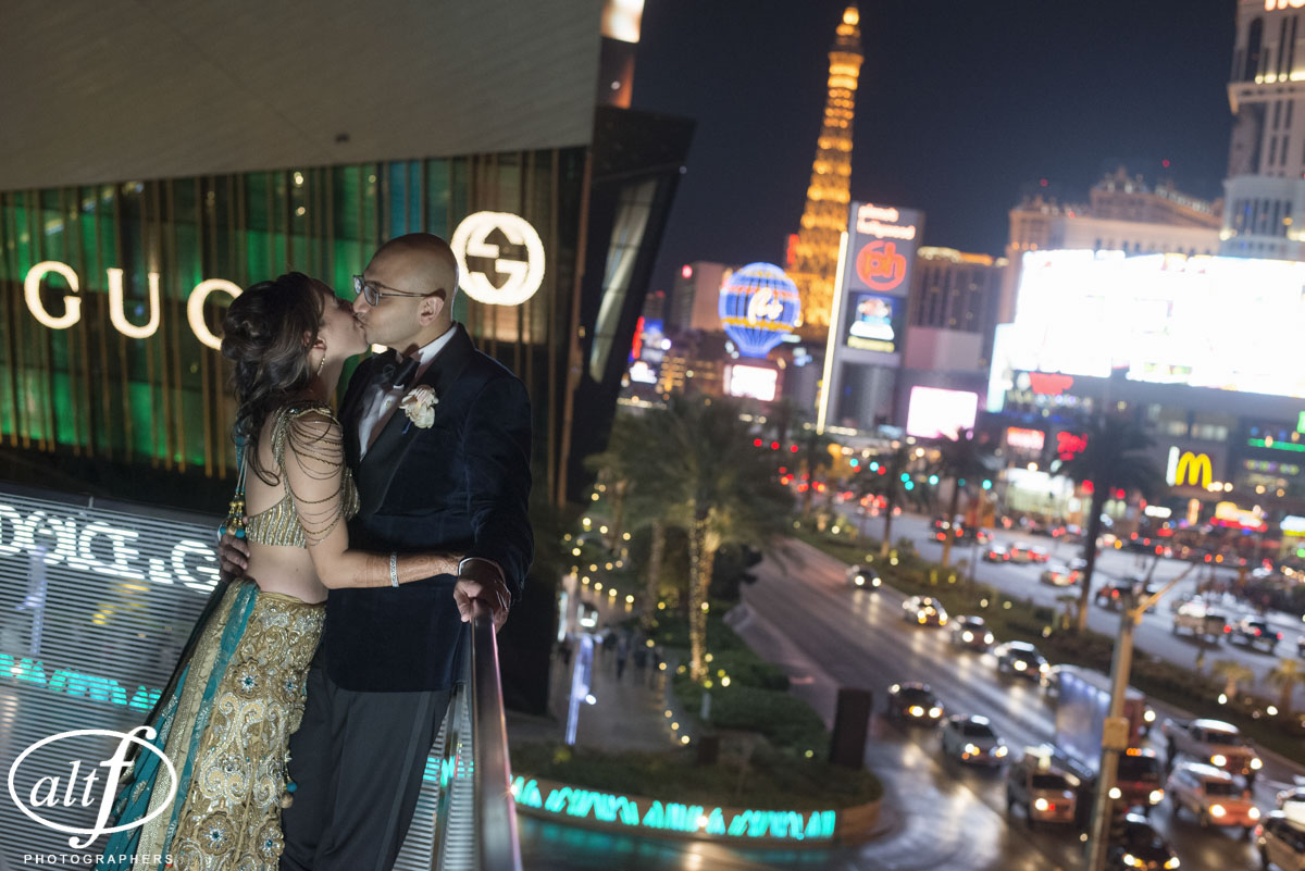 Portrait of the newly married Dr. and Dr. Patricia Shay and Snehal Bhoola taken on the balcony of the Mandarin Oriental Ballroom.  Indian Wedding at the Mandarin Oriental. Luxury Las Vegas Wedding Planner Andrea Eppolito. Photo by Altf Photography.