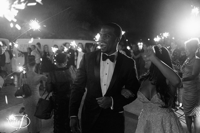 Black and white wedding photo. Wedding exit with sparklers by Las Vegas Wedding Planner Andrea Eppolito. Image by Altf.com.