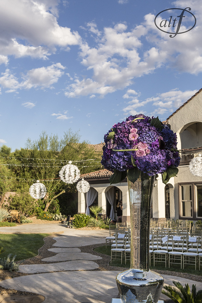 Wedding Ceremony in the backyard of the family estate. Las Vegas Wedding Planner Andrea Eppolito. Image by Altf.com.
